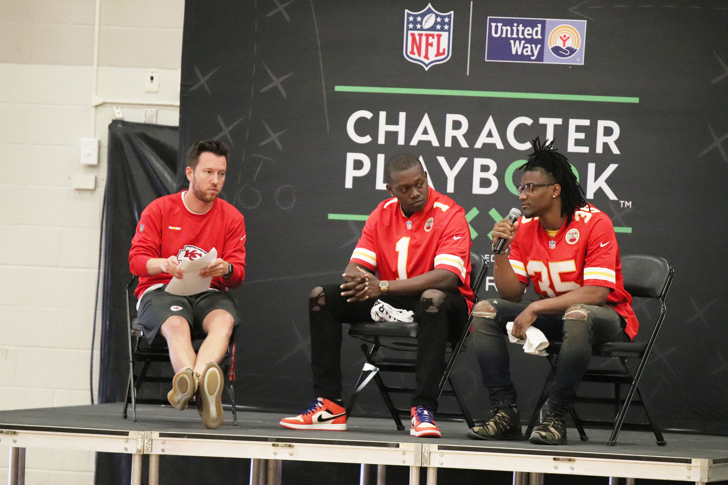 CODY THORN/Citizen photo Kansas City cornerback Charvarius Ward, right, answers a question during an assembly at Platte County Middle School on Friday, May 3. Next to him is teammate, Byron Pringle (center) and Kansas City Chiefs employee Tyler Banks, who served as the emcee.