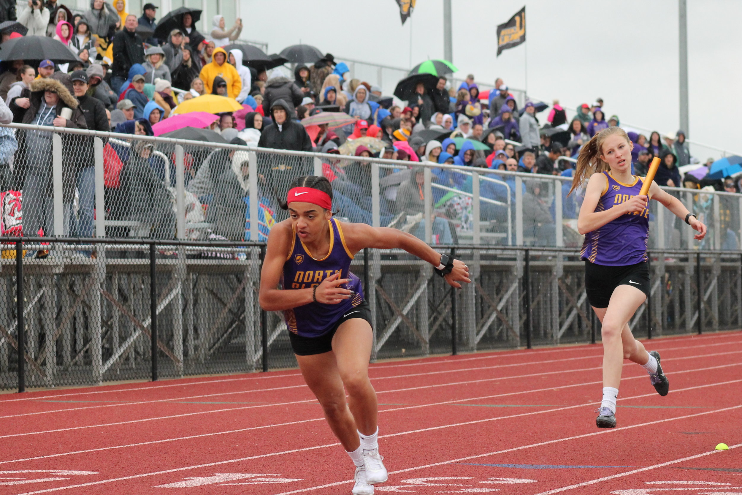 BREANNA CHEADLE/Special to the Citizen North Platte's Maddie O'Neill, left, awaits the baton from Madi Debord in the 4x200-meter relay during the Class 2 Sectional 4 meet held on Saturday, May 11 at Lathrop High School.