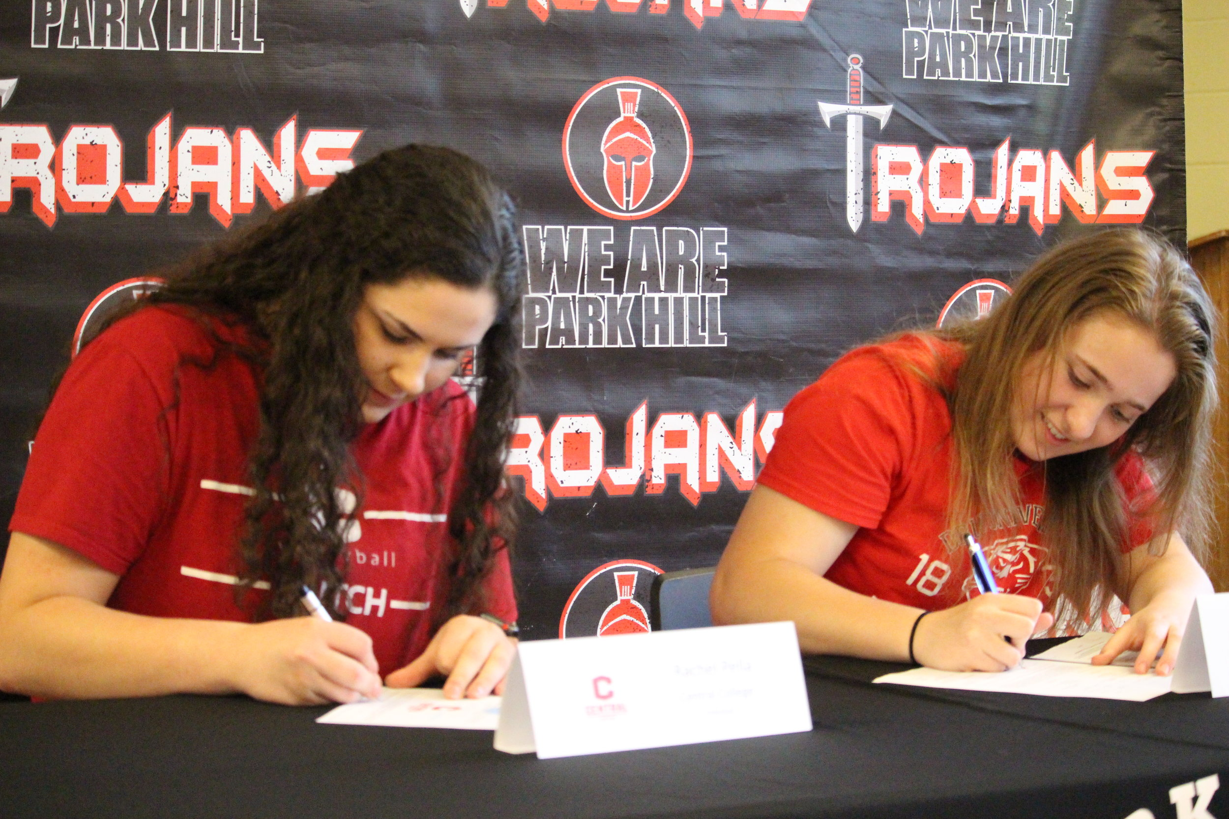 CODY THORN/Citizen photos  Park Hill students Rachel Pella, left, and Sabrina Lane signed letters of intent to play sports at the next level. Pella will play volleyball at Central College and Lane will compete in track and field for Drury.