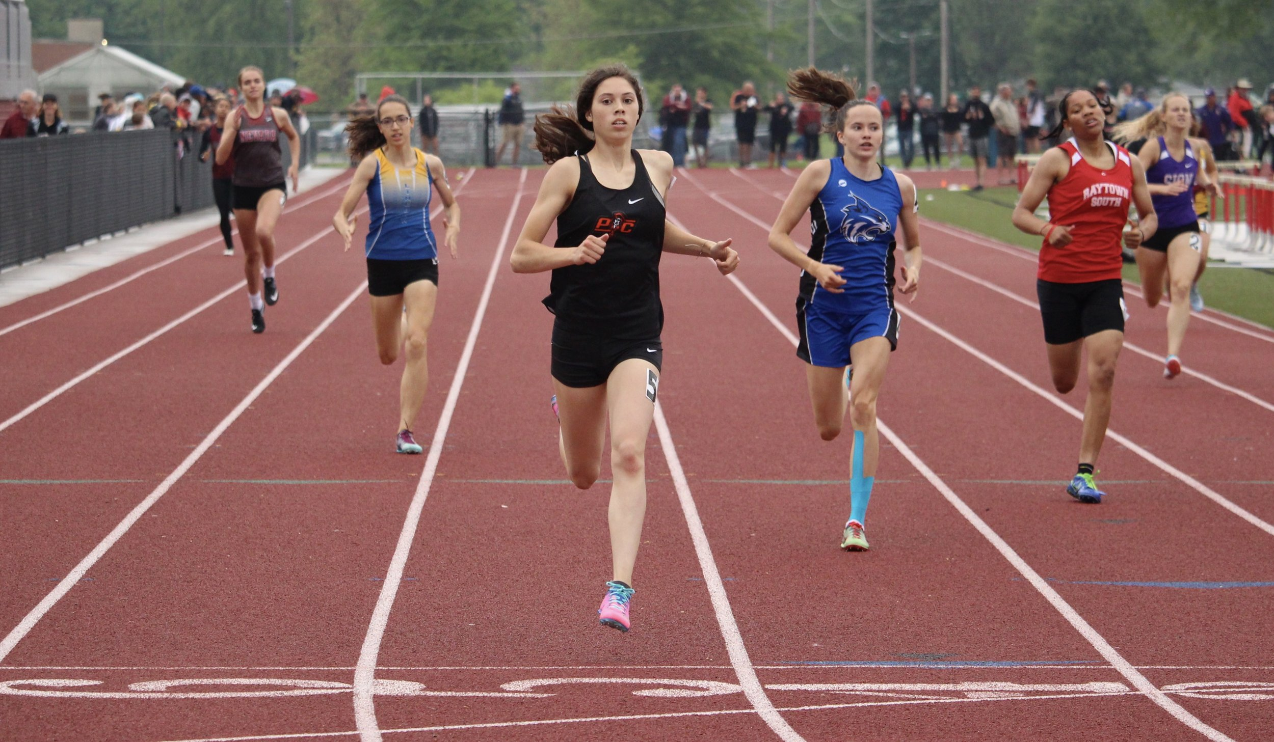 ROSS MARTIN/Special to the Citizen  Platte County sophomore Haley Luna, center, took first place in the 400-meter dash on Saturday, May 18 at the Class 4 Sectional 4 meet in Odessa. She set a new school record with a time of 58.28 seconds.
