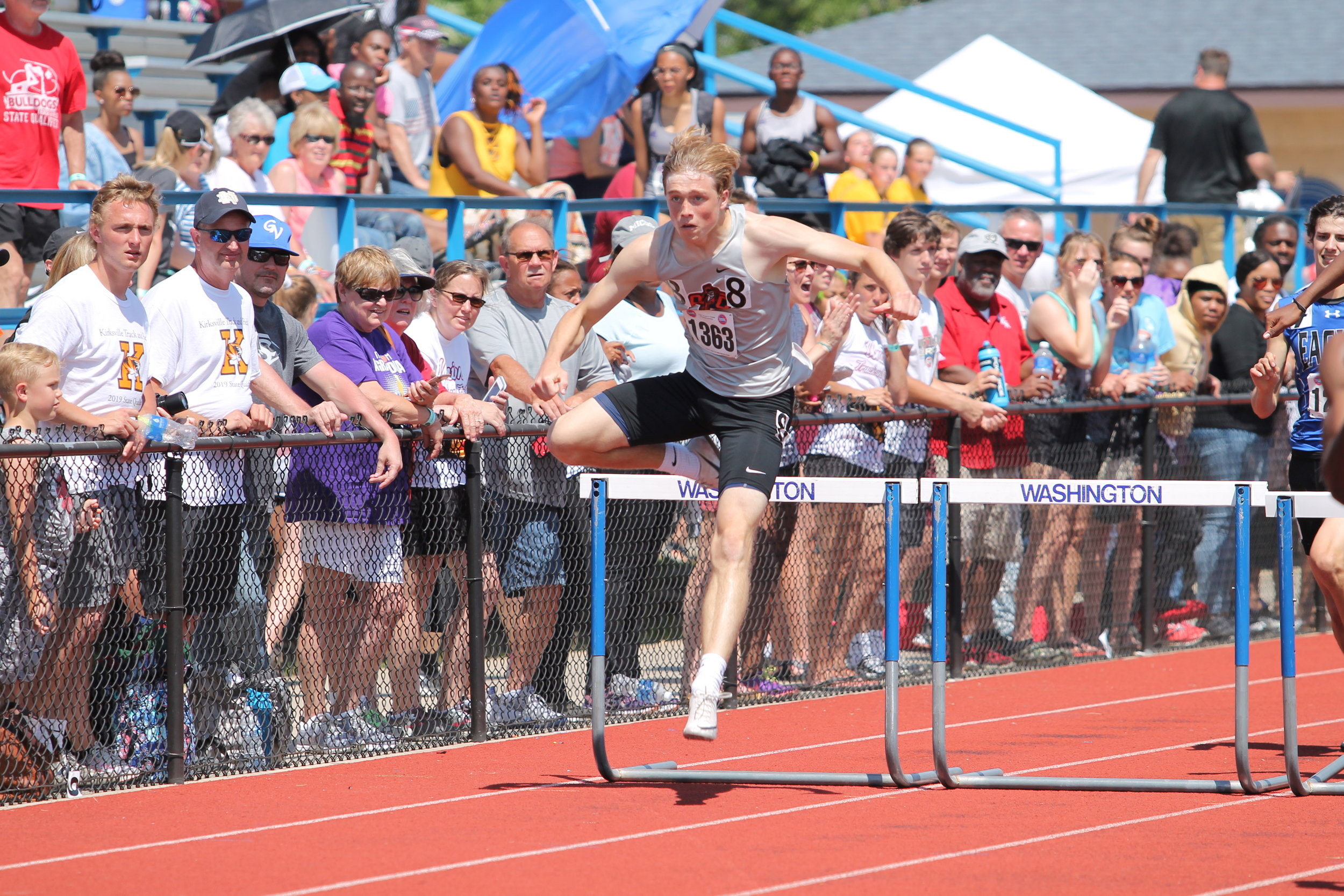 BREANNA CHEADLE/Special to the Citizen  Will Hay, right, took third place in the 300-meter hurdles despite running on the outside lane during the Class 4 championships on Saturday, May 25.