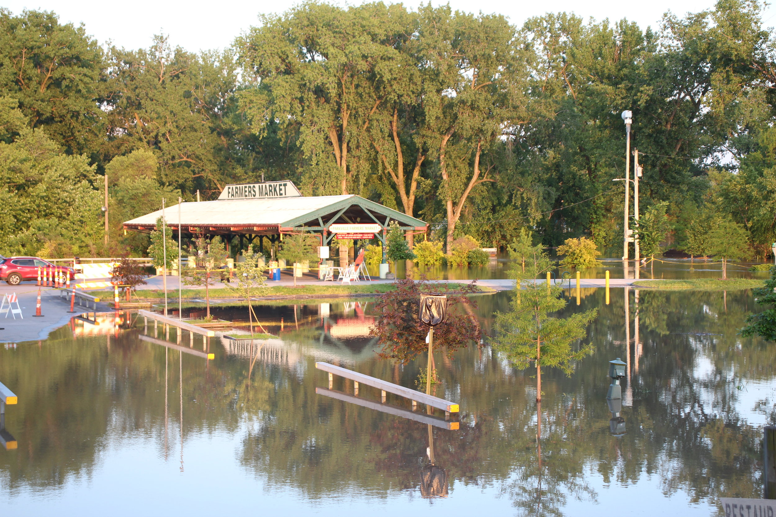 Platte and English Landing parks were flooded again last week, with flood waters rising up into the city parking lots and to the Parkville Farmer's Market pavilion. These photos were taken Saturday, June 1 at the Missouri River crest near sunset.