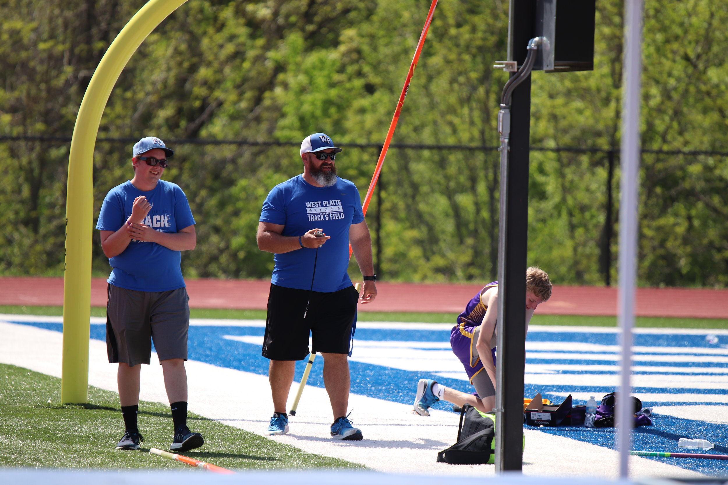 CODY THORN/Citizen photo  West Platte track and field coach Steve Feiden, right, times the girls 4x400-meter relay during the Class 2 District 8 meet earlier this year. Feiden recently resigned as a coach. Next to Feiden is Nate Kendall.