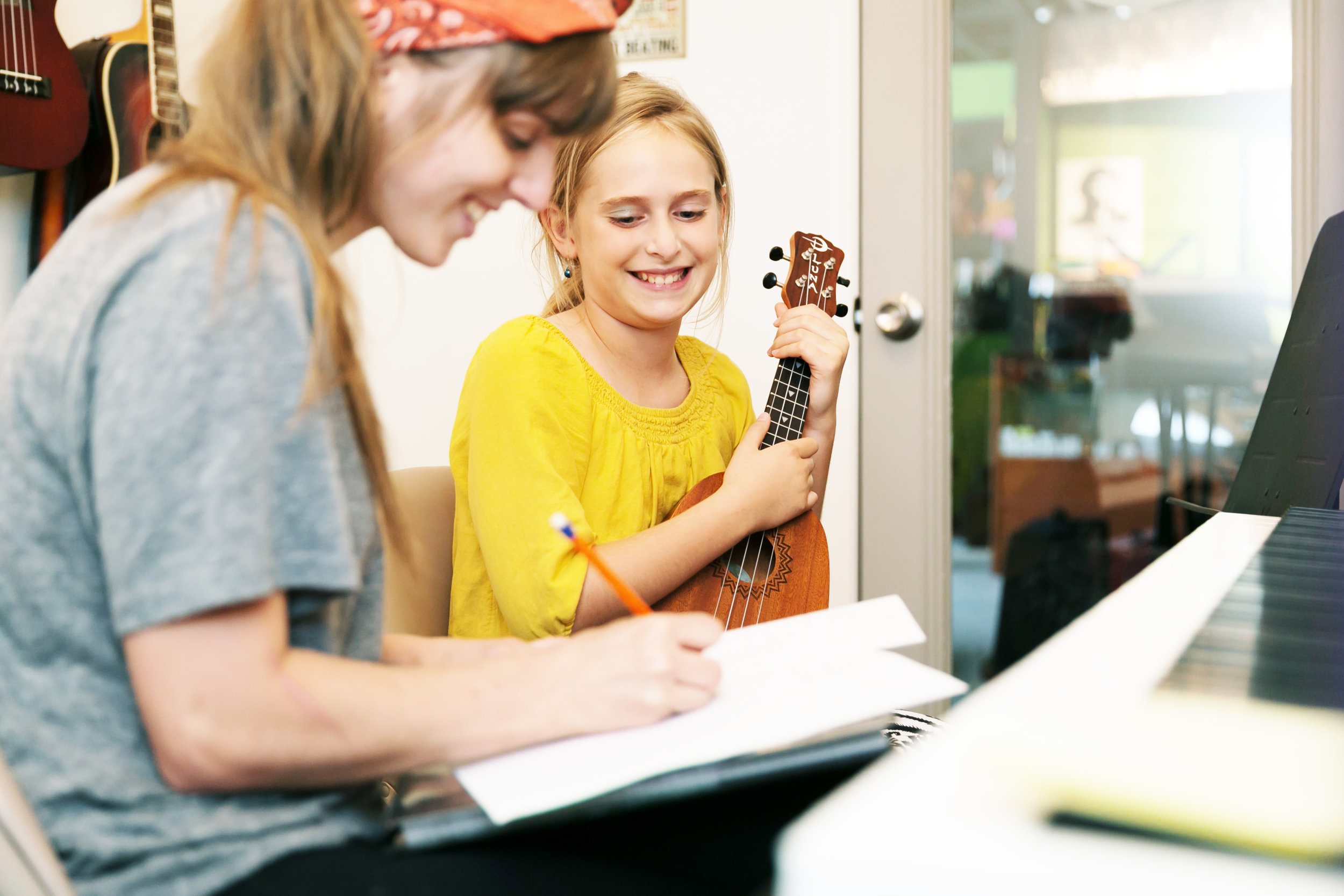 ASHLEY ELWELL/Three Three Photography Lily Lagergren, right, gets instructions from Diana Hunter, her voice and ukulele instructor at the KC Music Academy in Platte Woods.