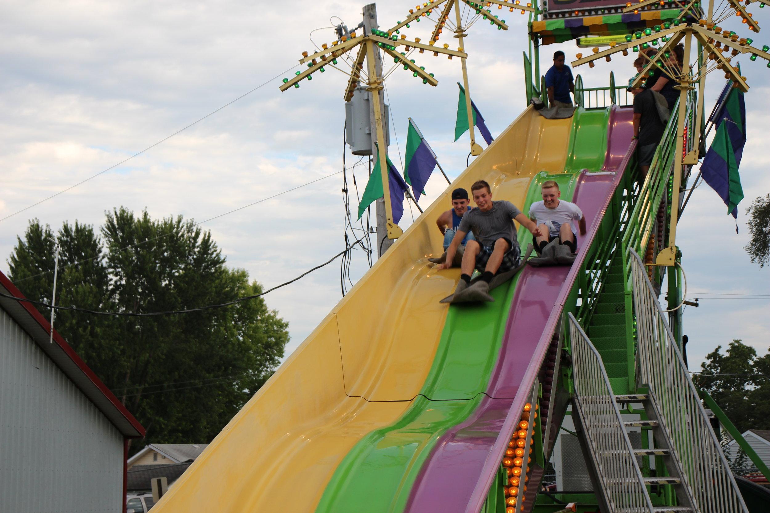 teenagers on slide.JPG