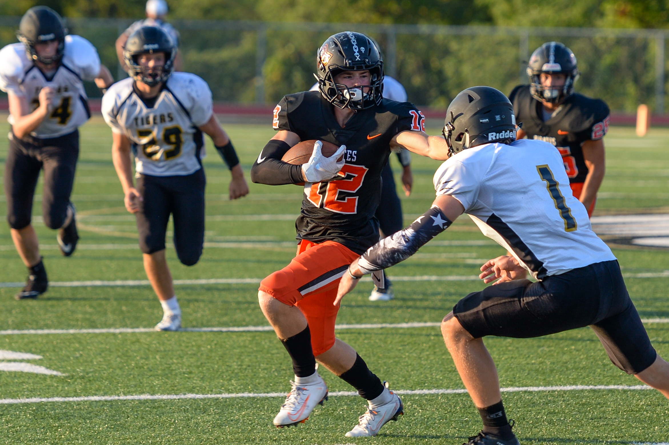 TODD NUGENT/Nugent Photography  Platte County's Cam Schieb stiff-arms an Excelsior Springs defender during a jamboree on Friday, Aug. 23 at Exclesior Springs High School.
