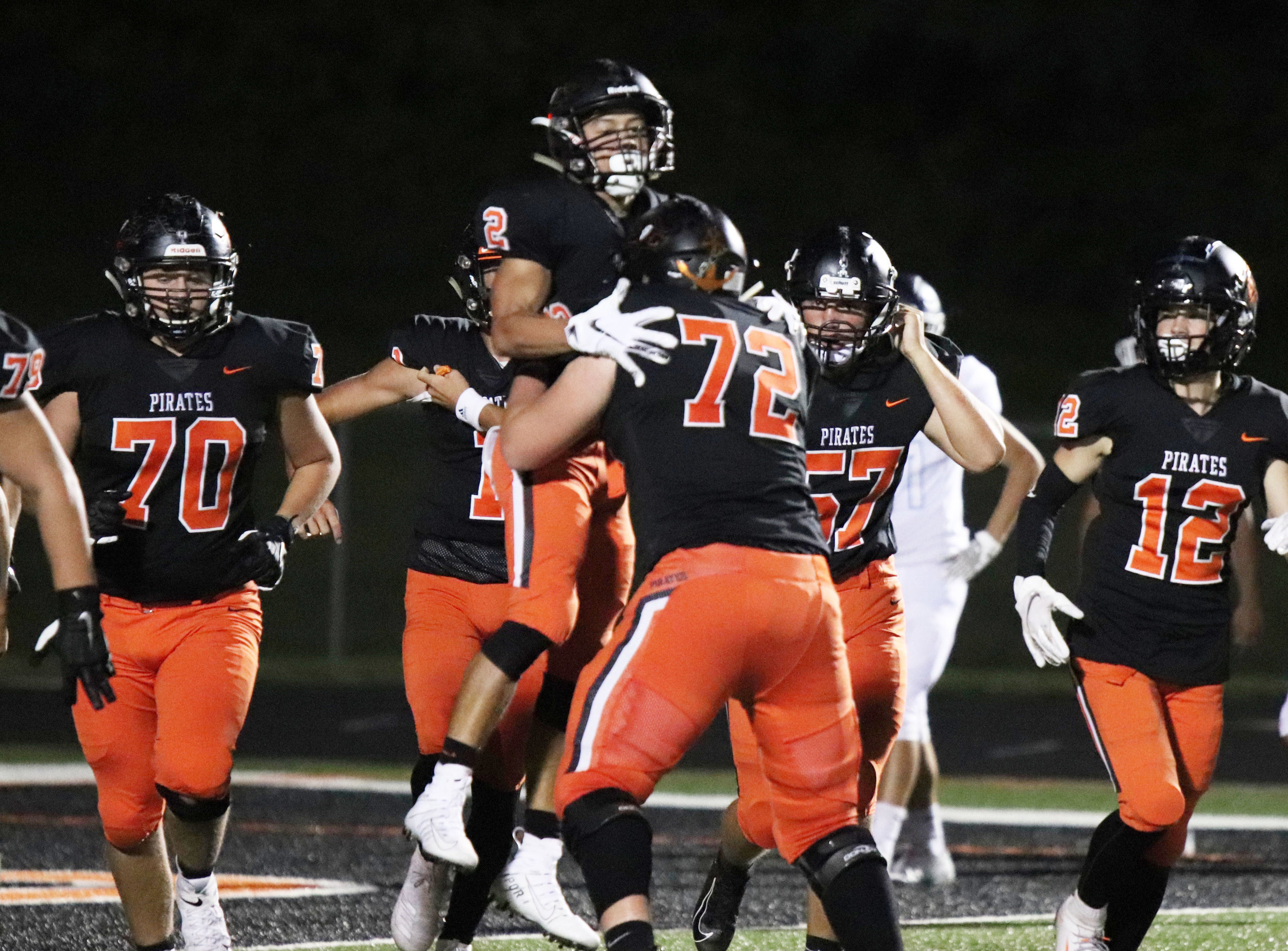 ROSS MARTIN/Special to the Citizen Platte County offensive lineman Trey Butcher (72) lifts running back Trey Phan in the air after he scored his second touchdown against Oak Park during a game on Friday, Aug. 30 at Pirate Stadium in Platte City.