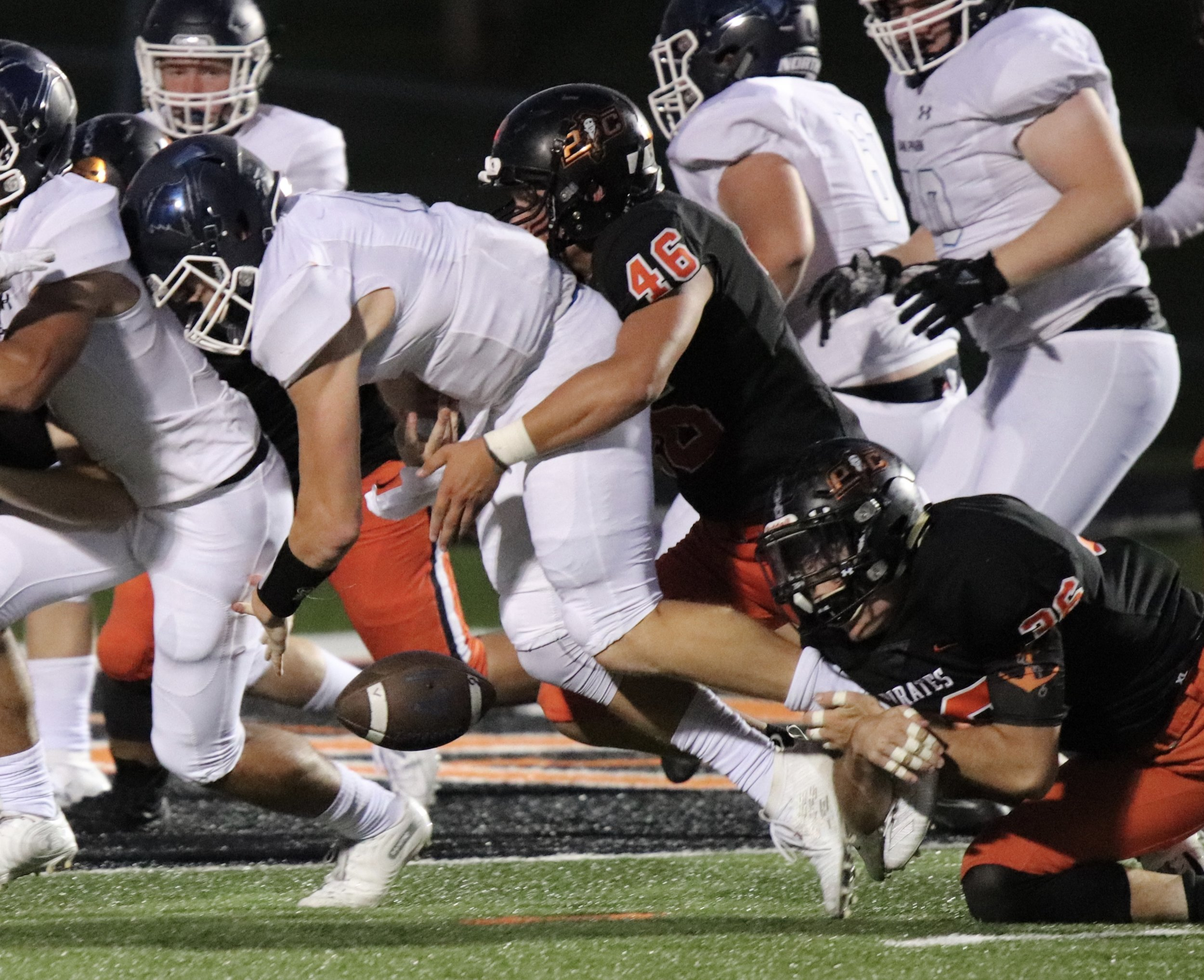 ROSS MARTIN/Special to the Citizen Gabe Harmon (46) and Forrest Boynton combine to sack Oak Park quarterback Blake Bland and force a fumble on the play late in the second quarter of a game on Friday, Aug. 30 at Pirate Stadium in Platte City.