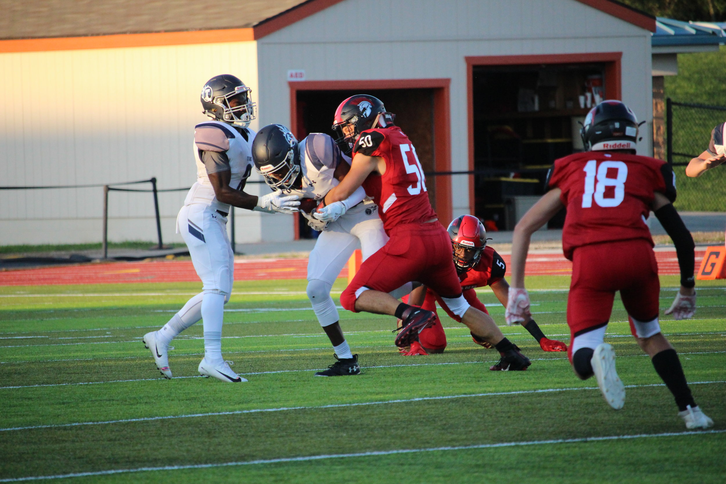 CODY THORN/Citizen photo  Park Hill linebacker Vince Reichert (50) tackles Lee's Summit West running back Taylor Wilson during a Suburban Conference Gold Division game on Friday, Aug. 31 at Preston Field in Kansas City North.
