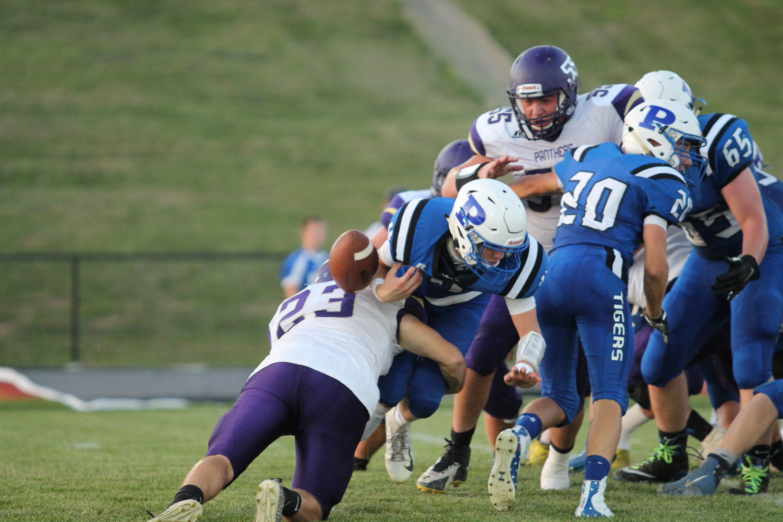 BREANNA CHEADLE/Special to the Citizen  North Platte's Caine Huffman (23) forces a fumble on his hit on the Princeton quarterback during the game on Friday, Sept. 6 in Princeton. The Tigers won the game 41-14 to keep North Platte winless.