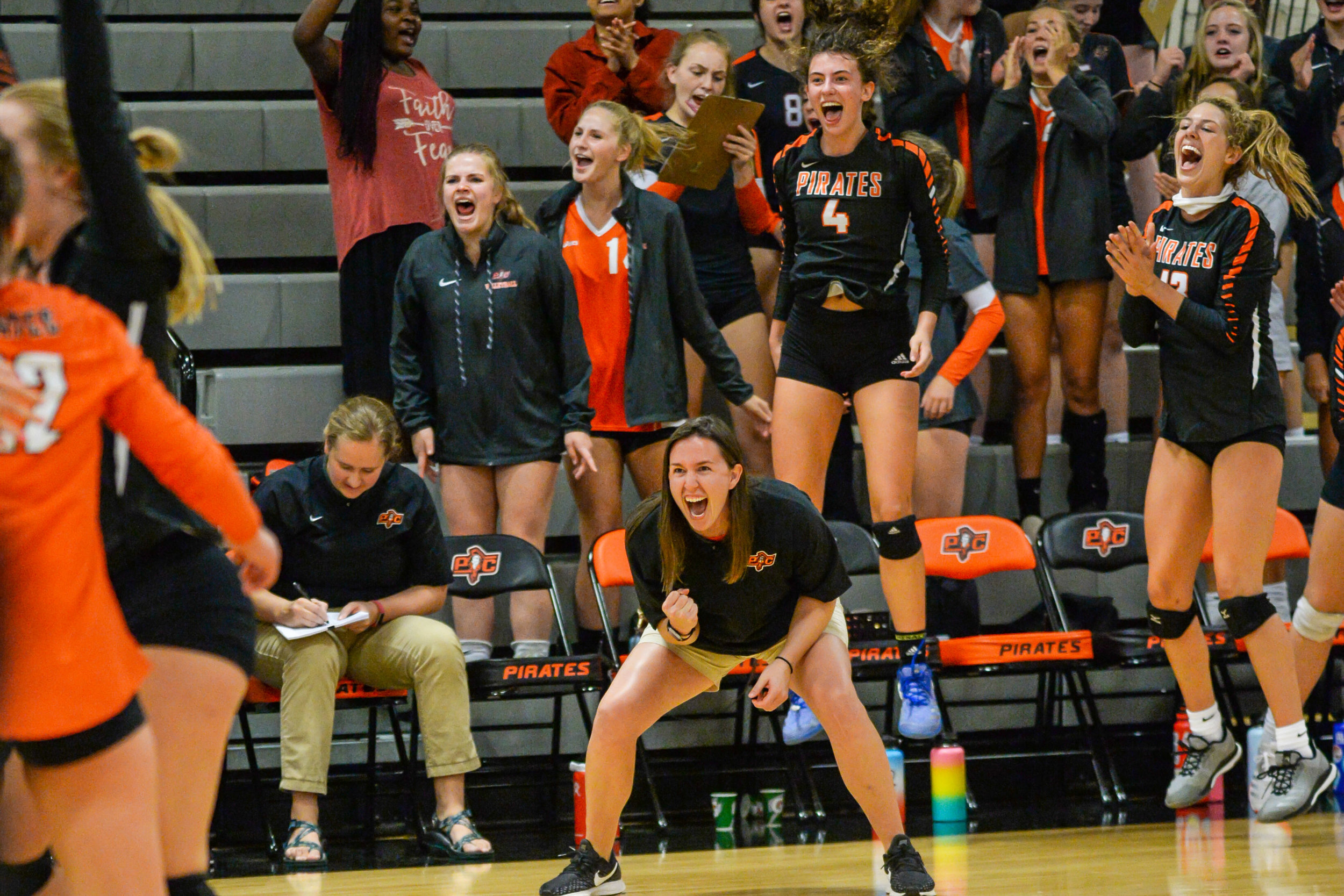 TODD NUGENT PHOTOGRAPHY/Special to the Citizen  Platte County volleyball coach Katlyn Donovan, center, and her team celebrates the end of a win against Park Hill on Thursday, Sept. 5 at Platte County High School.