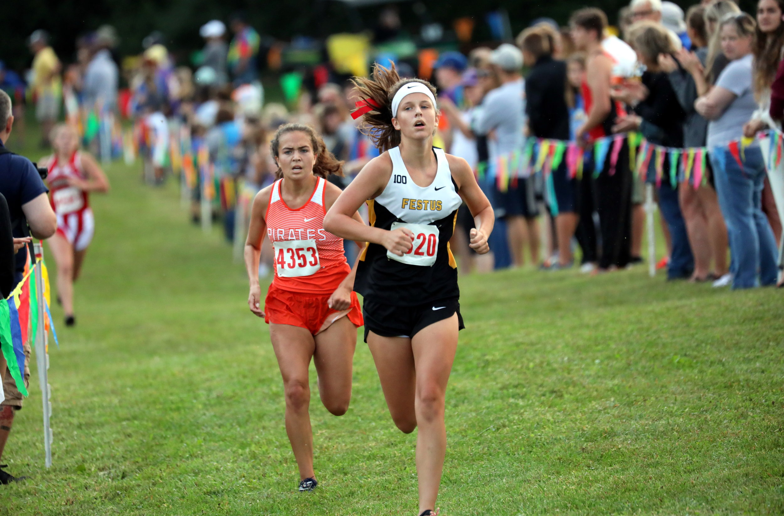 KCPREPREPORT/Special to the Citizen  Platte County's Taylor Giger (4353) follows Festus' Allison Faerber toward the finish line on Saturday, Sept. 7 at the Tim Nixon Invitational in Liberty.