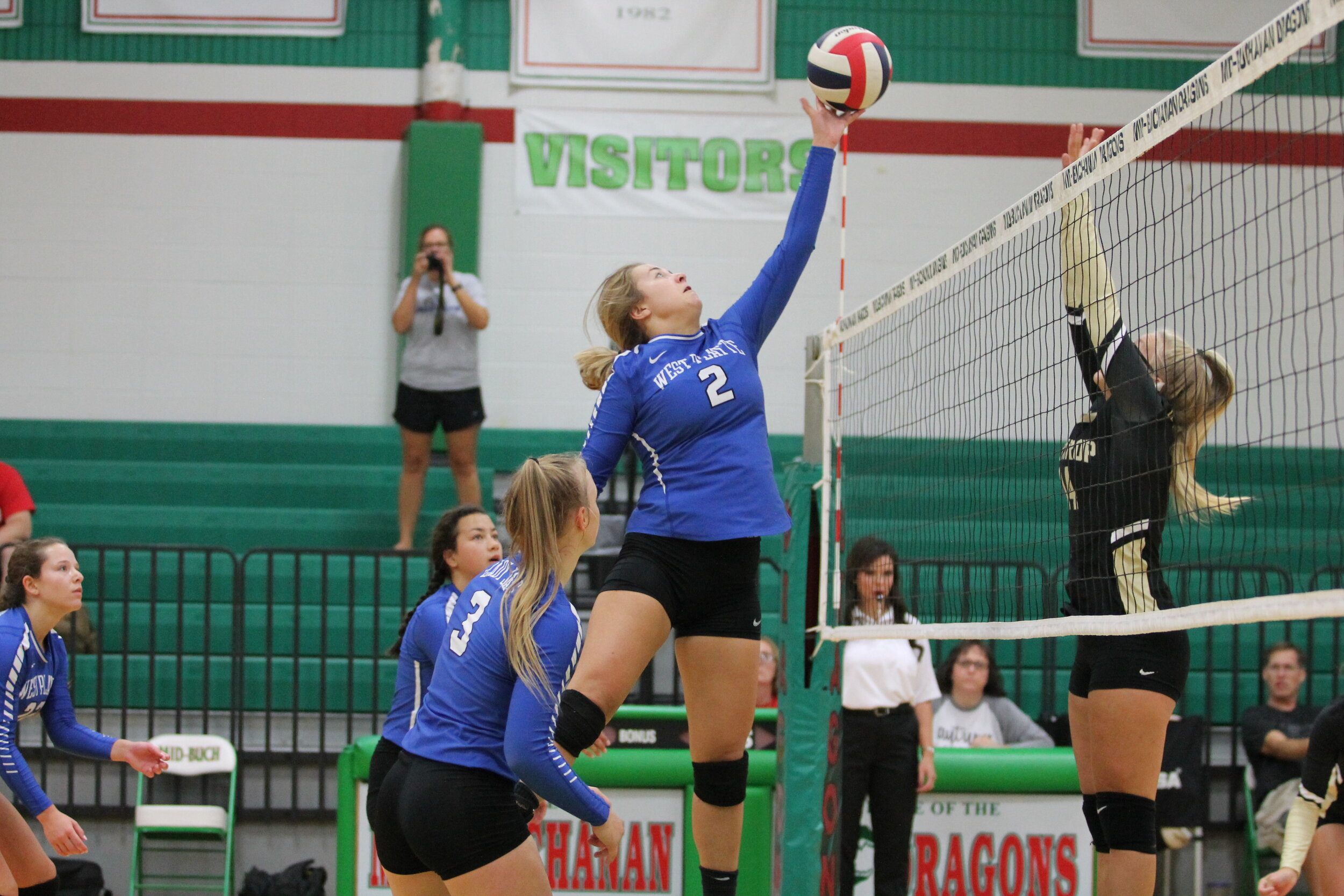 BREANNA CHEADLE/Special to the Citizen  West Platte's Sam Rotterman (2) goes up for a kill in the KCI Tournament on Saturday, Sept. 7 at Mid-Buchanan High School. The Bluejays reached the title game and lost in two games to Lawson.