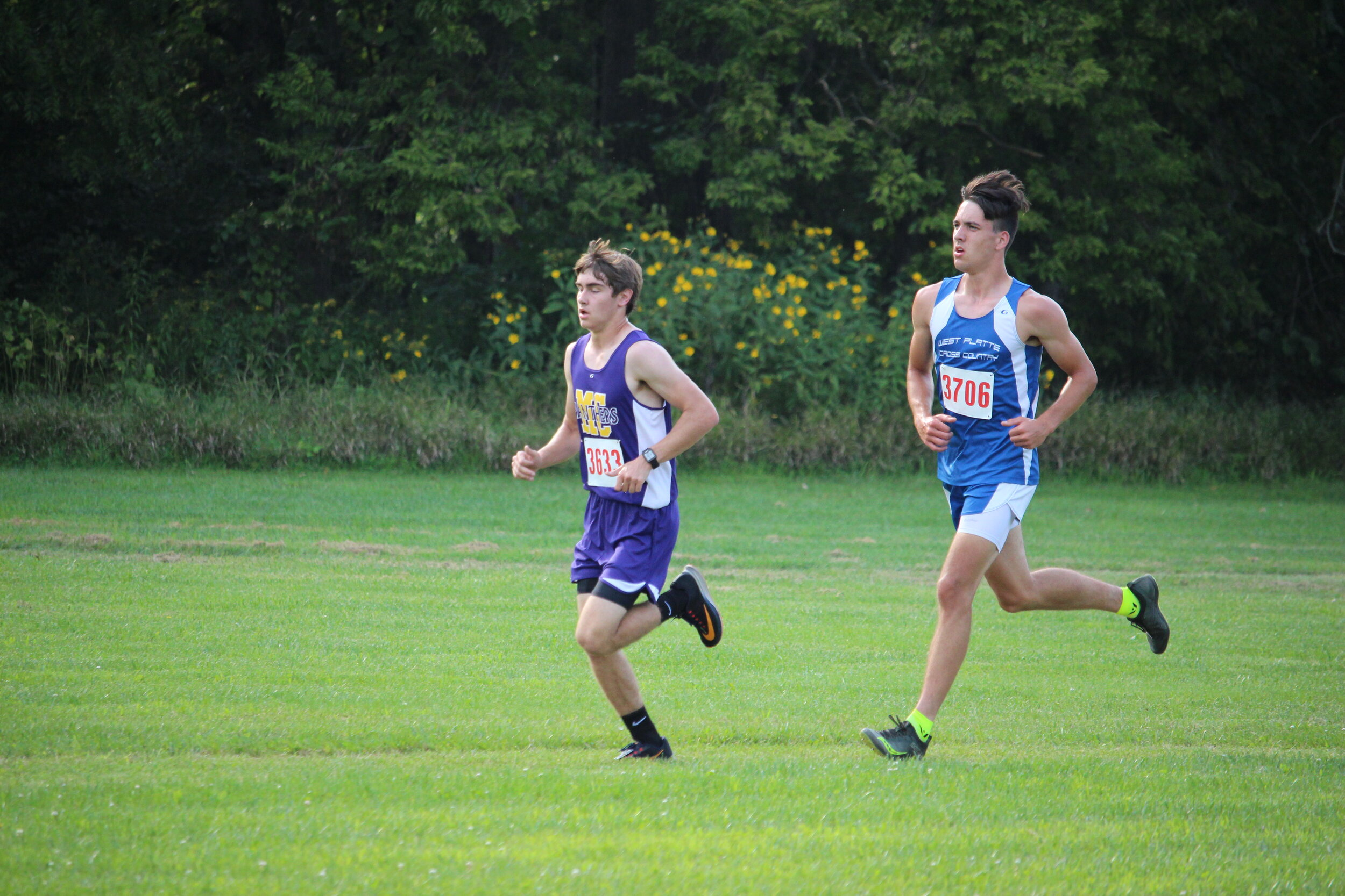 West Platte's Phillip Pattison, right, runs behind Mound City's Lane Zembles during the North Platte 2-miler race held on Tuesday, Sept. 3 in Dearborn. Pattison won the race and then won his second race of the season on Saturday in Lee's Summit.  CODY THORN/Citizen photo