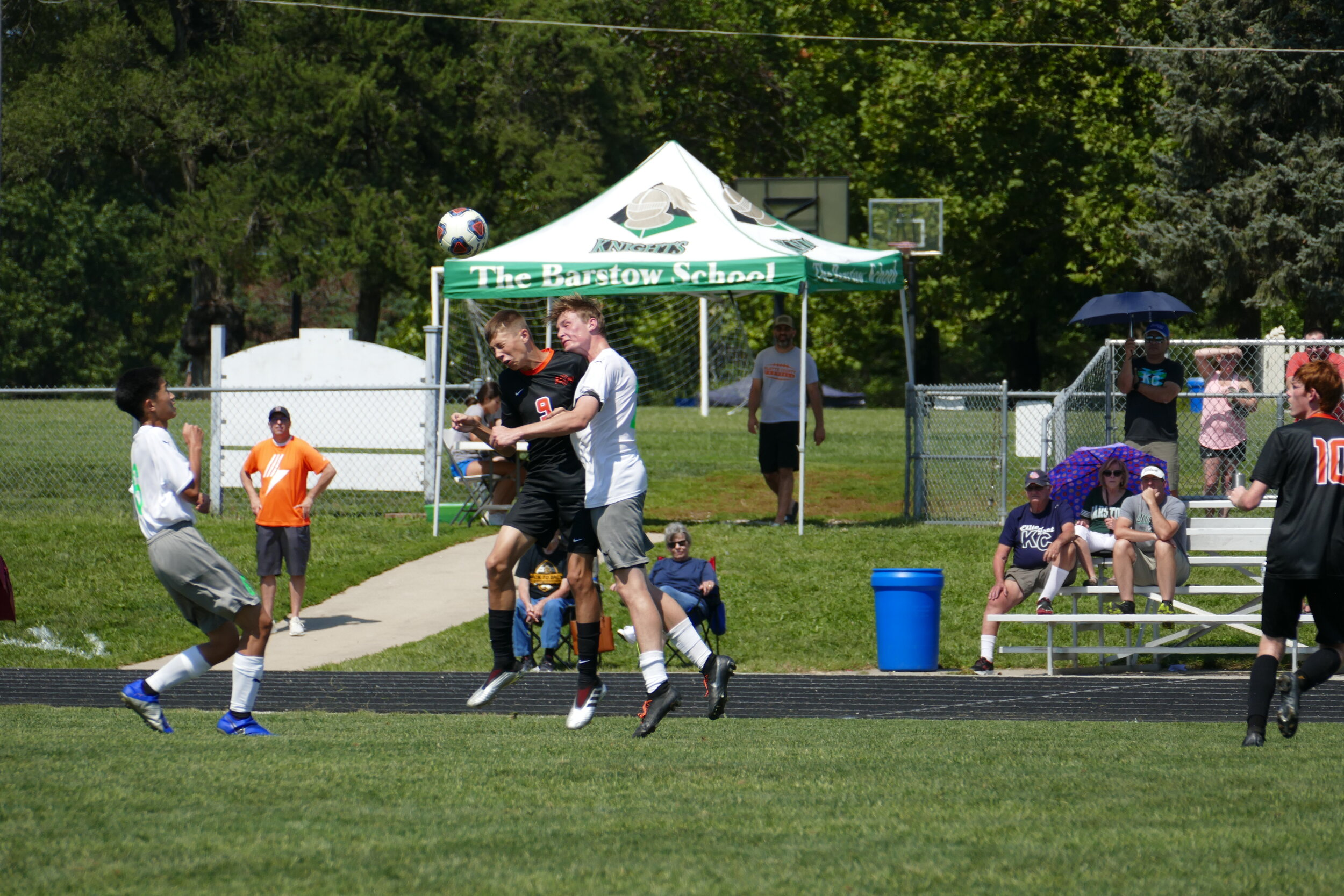 DEREK BIGUS/Special to the Citizen  Platte County's Joey Habel, left, goes up for a head along with a Barstow player during the championship game of the Barstow Tournament on Saturday, Sept. 7 in Kansas City. Platte County won 3-0.