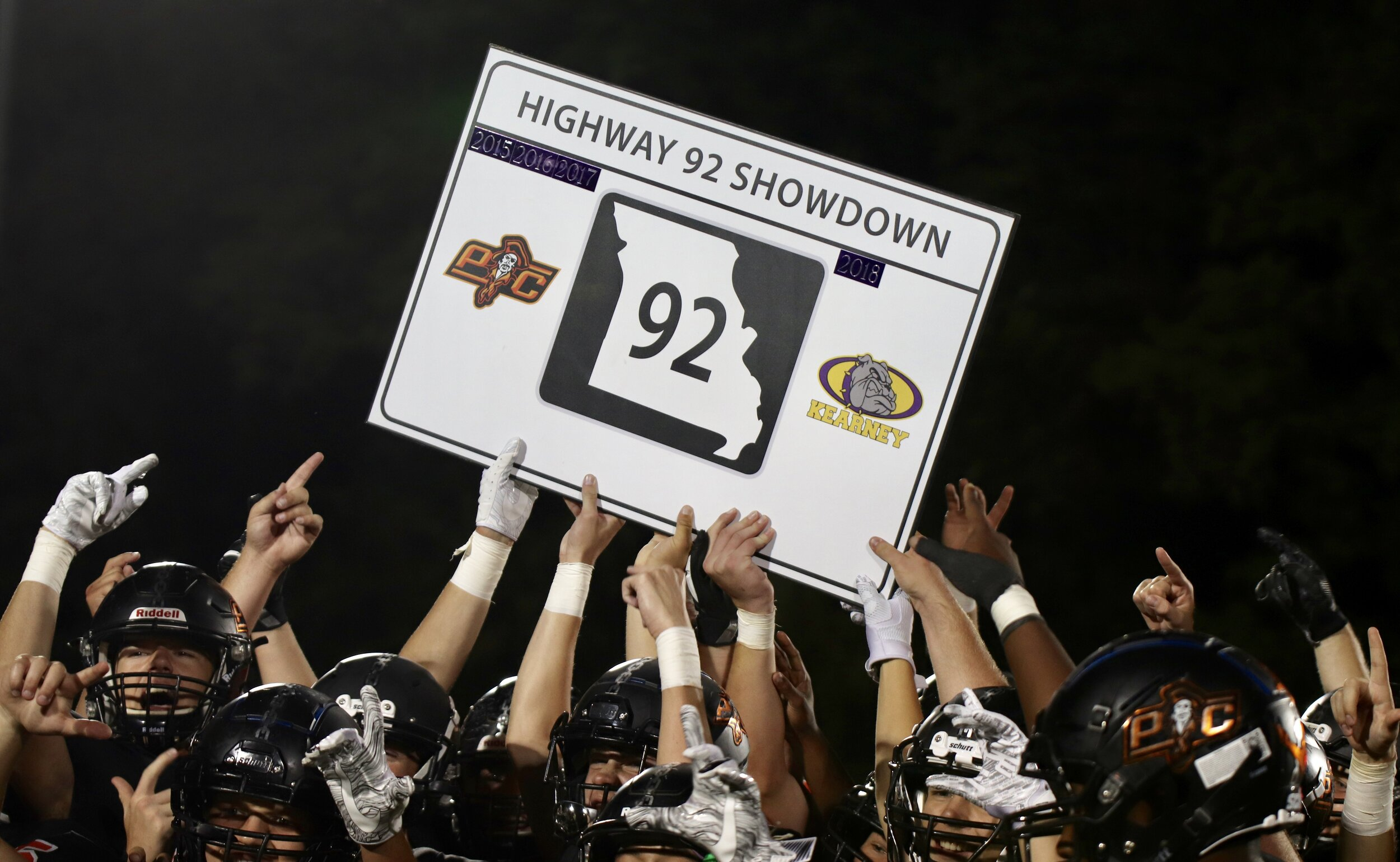 ROSS MARTIN/Special to the Citizen  Platte County players celebrate after getting their hands on the Highway 92 Showdown road sign traveling trophy after a 51-14 victory on Friday, Sept. 13 at Pirate Stadium in Platte City.