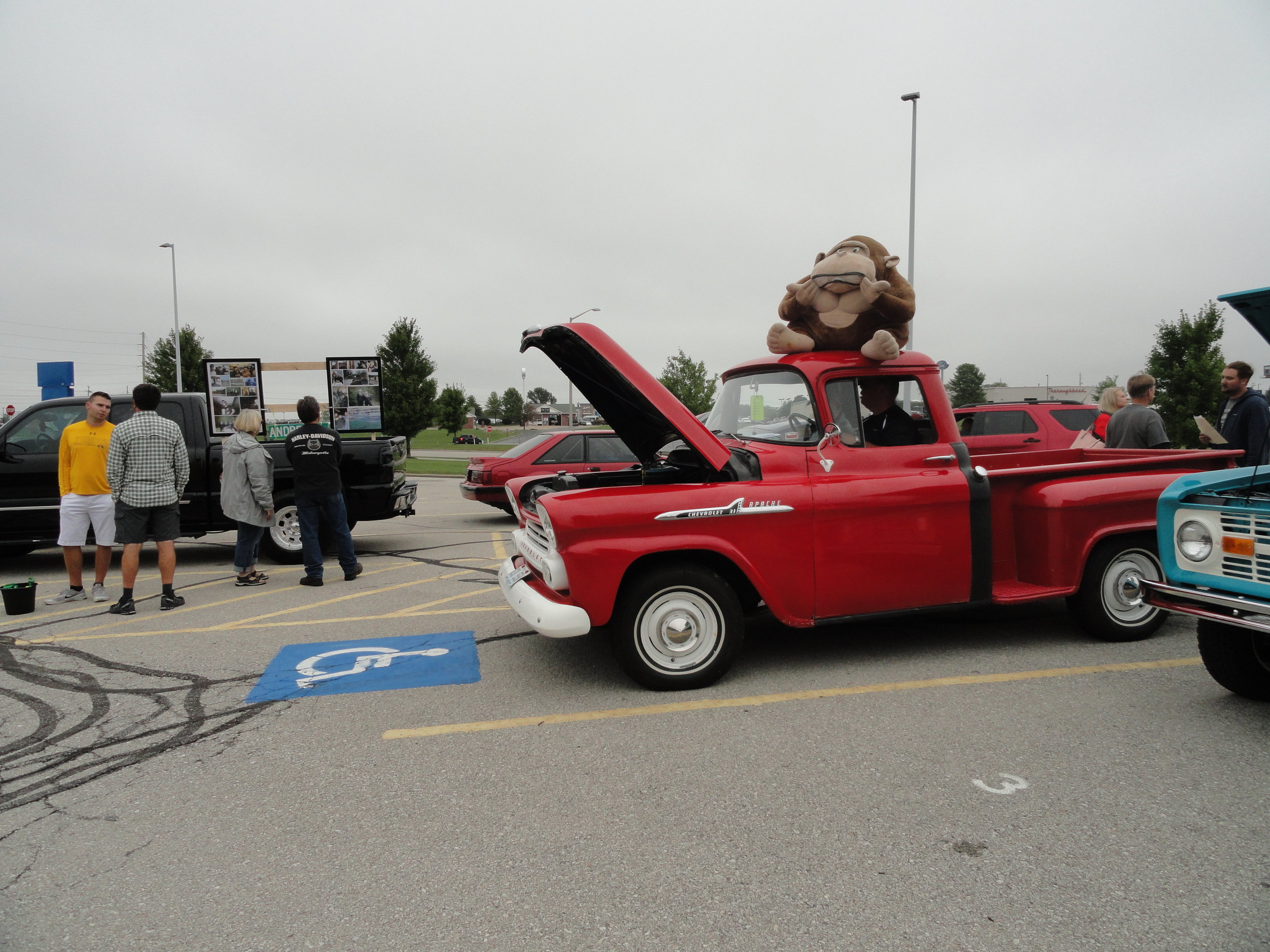 car show attendees and 1955 Chevy pick up.JPG