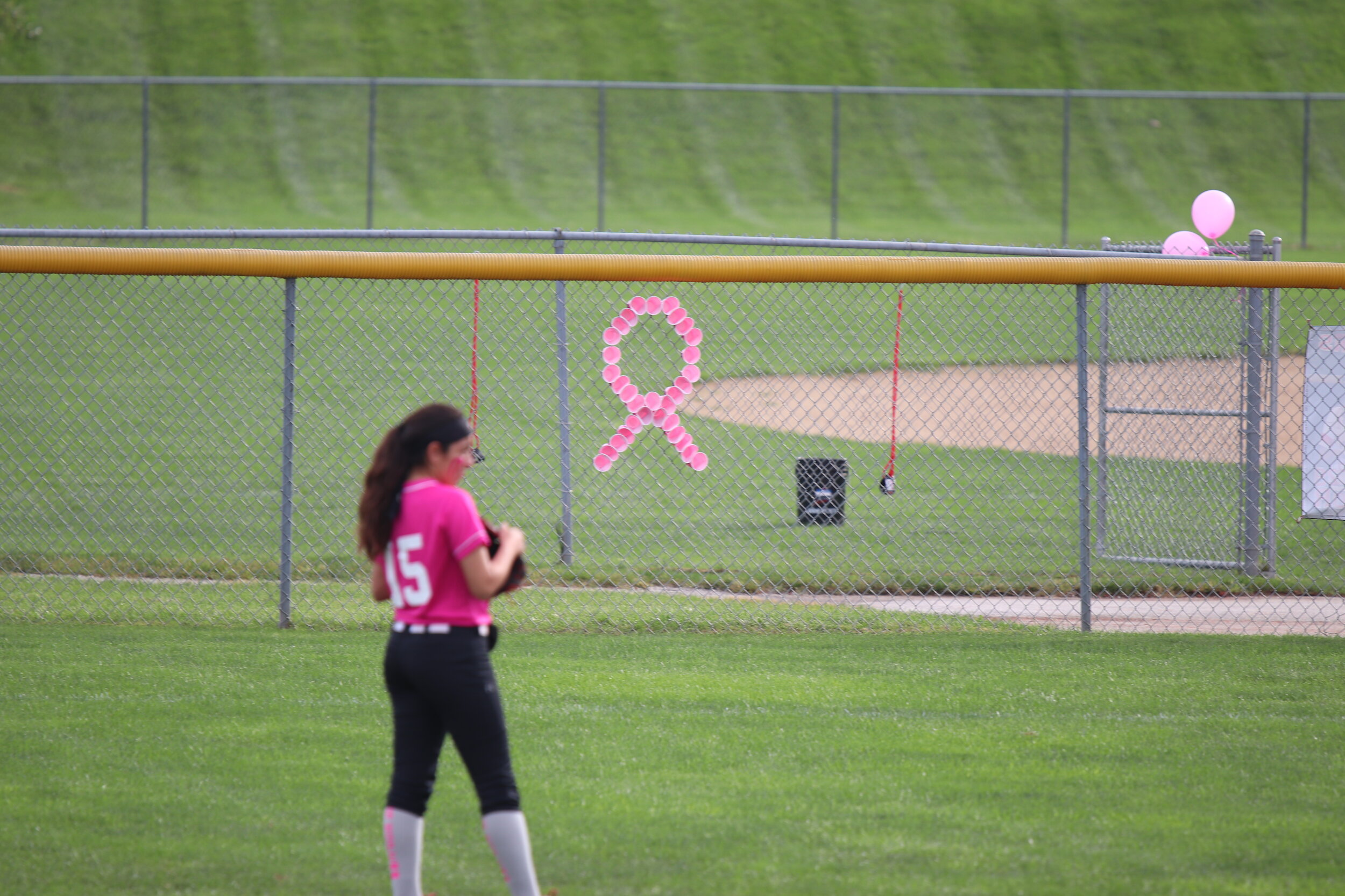CODY THORN/Citizen photo Park Hill outfielder Nia Muniz stands in right field during a game on Thursday, Oct. 3. The hosted a 'Pink Out' game for the third straight year to honor the legacy of the late Jill (Bailey) Heckman.