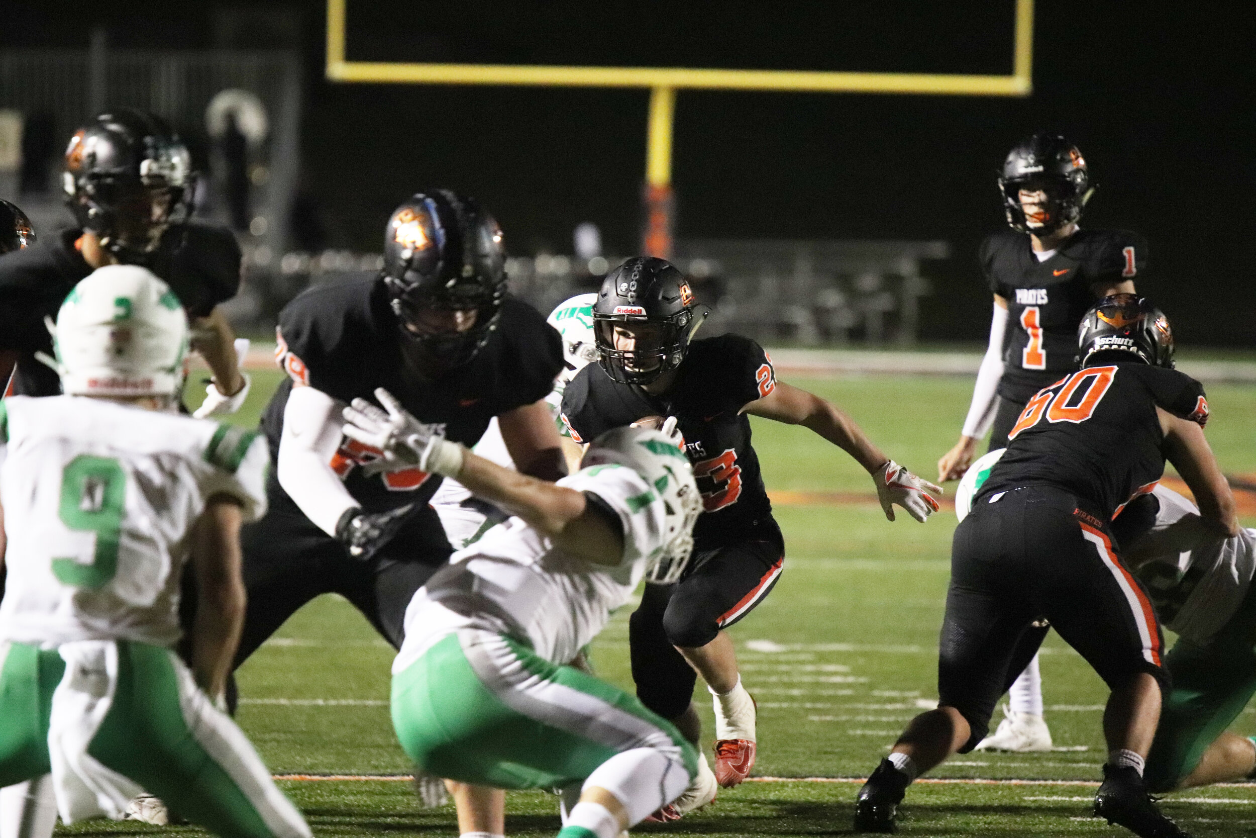 ROSS MARTIN/Special to the Citizen  Platte County's Cayden Davis, center, runs while getting an opening from offensive linemen Wyett Wallingford (79) and Luek Seigel (60) during a game against Smithville on Friday, Oct. 4 at Pirate Stadium. Platte County won 15-0.