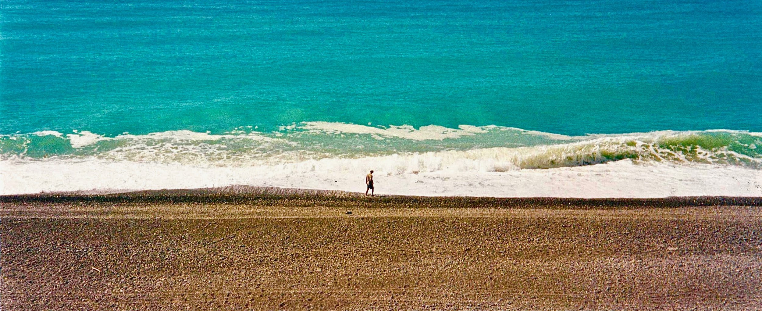 NZ jason walking on beach wide shot 2.jpg