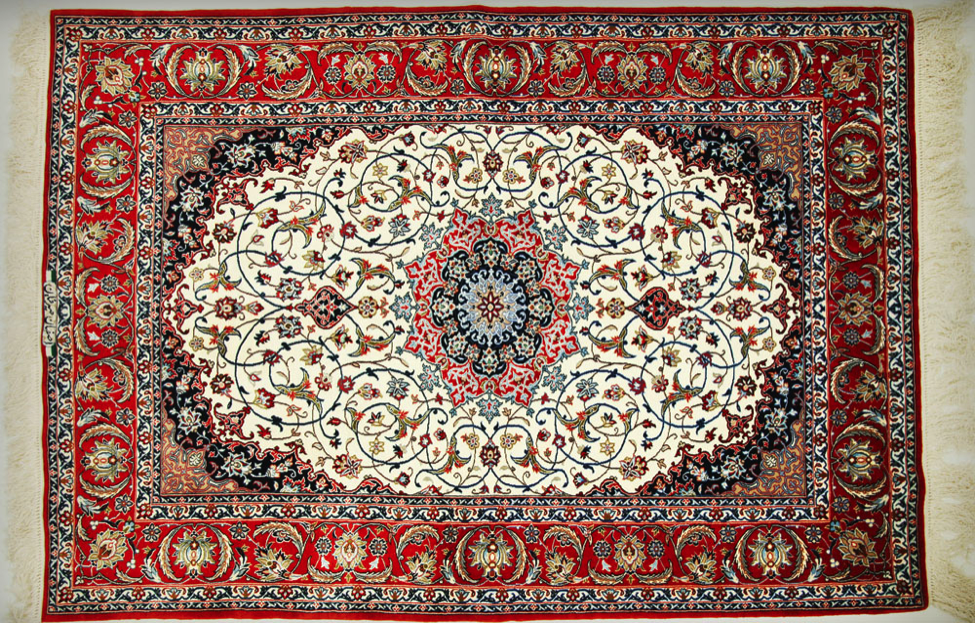Isfahan rugs are knotted on either silk or cotton foundations, with 500-700 Persian knots per square inch, using exceptionally good quality wool for the pile, which is normally clipped quite low. Very fine museum grade, Isfahan rugs could reach to 900 knots per square inch and even more. A range of traditional designs are still used (including allover Shãh Abbãsi, vase, Tree of Life and pictorial schemes), but the most popular is based on a circular central medallion set against an elegantly sculpted field decorated with intricately purling vine palmette and floral motifs.