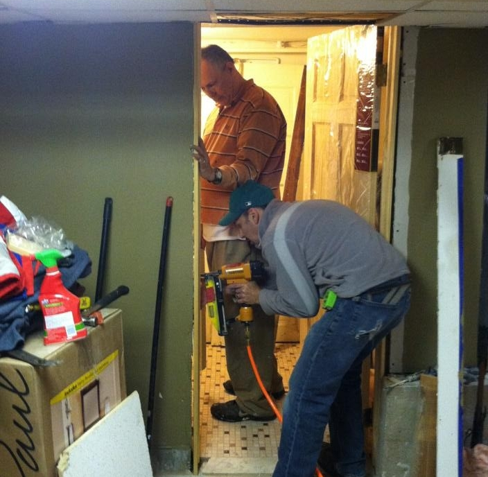 Ron and Don install another door.