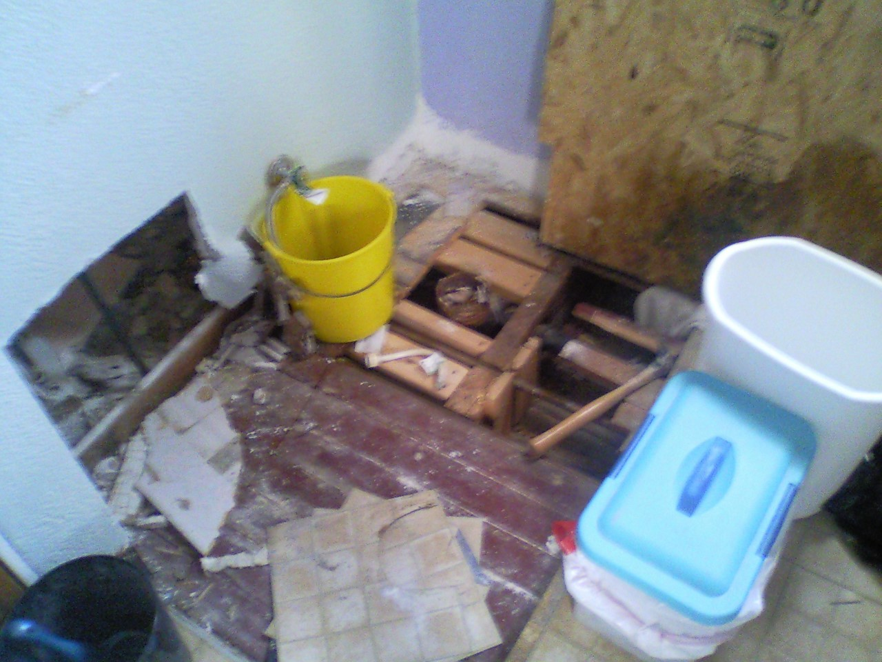 This shows damage to bathroom floor being repaired.