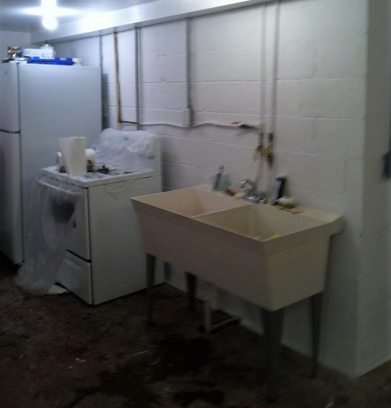 Sink and refrigerator were reinstalled after painting.