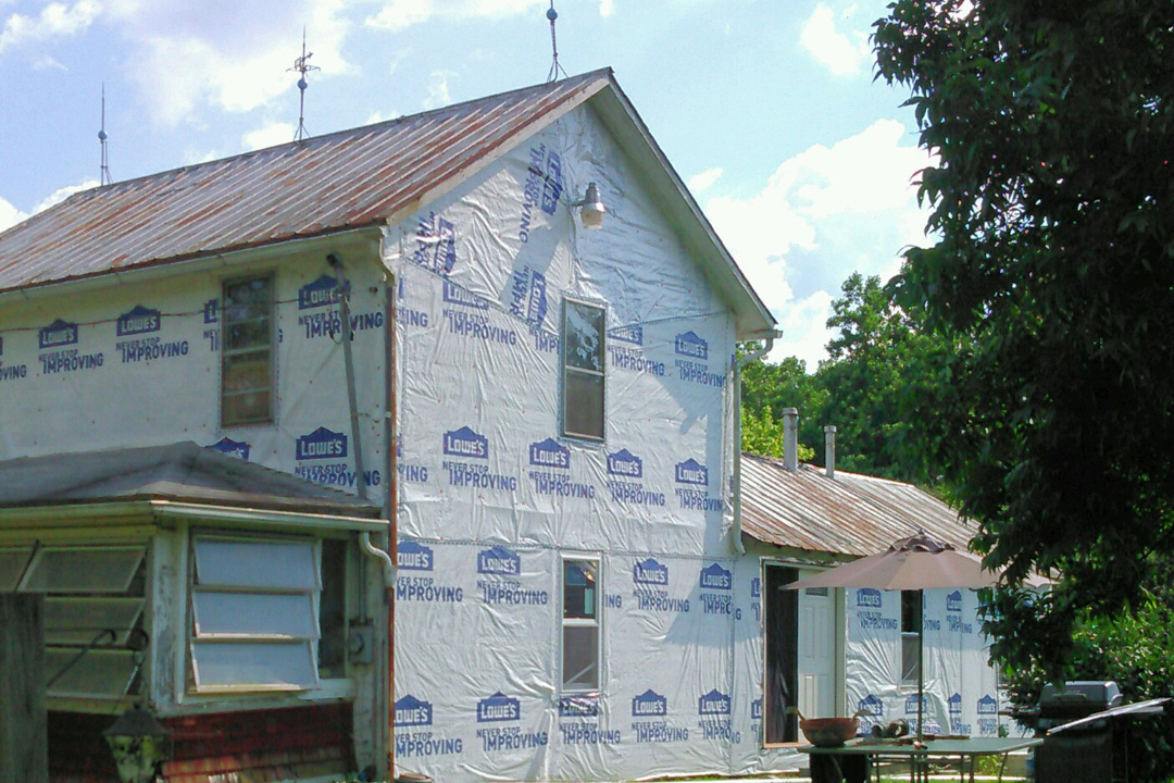 This picture shows the house after the house wrap was completed.