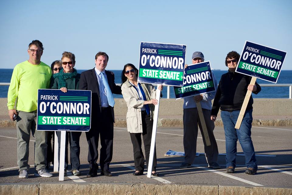 State Senate candidate Patrick O'Connor (in suit) with a contingent of Hull signholders. At left is Bob DeCoste, O'Connor's Hull coordinator.