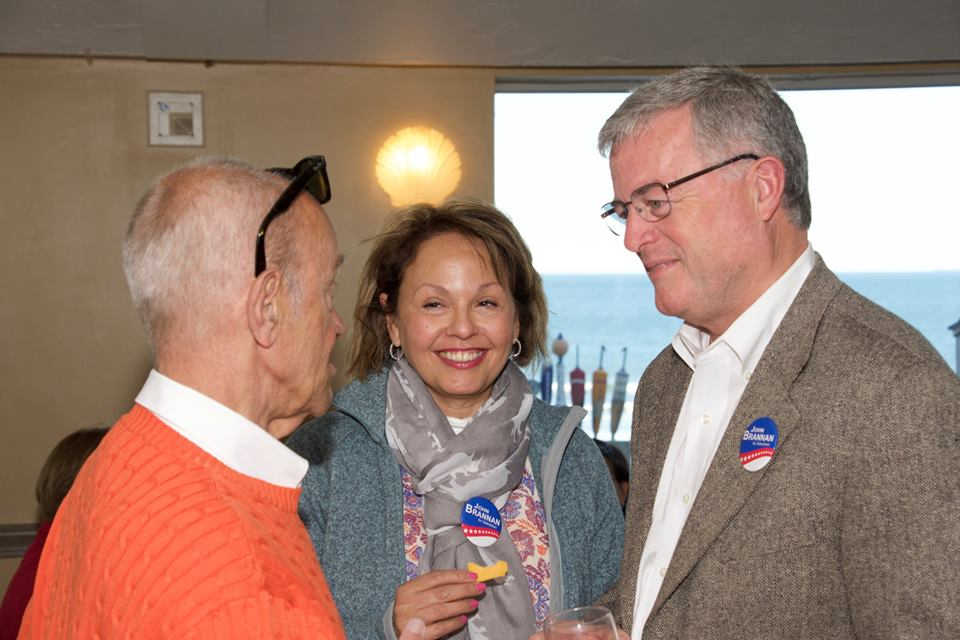 John Brannan [R], candidate for reelection to the board of selecmen, and his wife, Lita, speak with a voter.