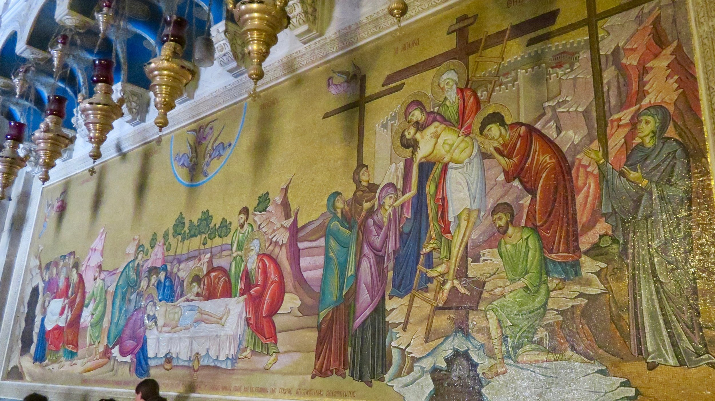 Mosaic depicting the crucifixion and burial of Jesus in the Church of the Holy Sepulchre.