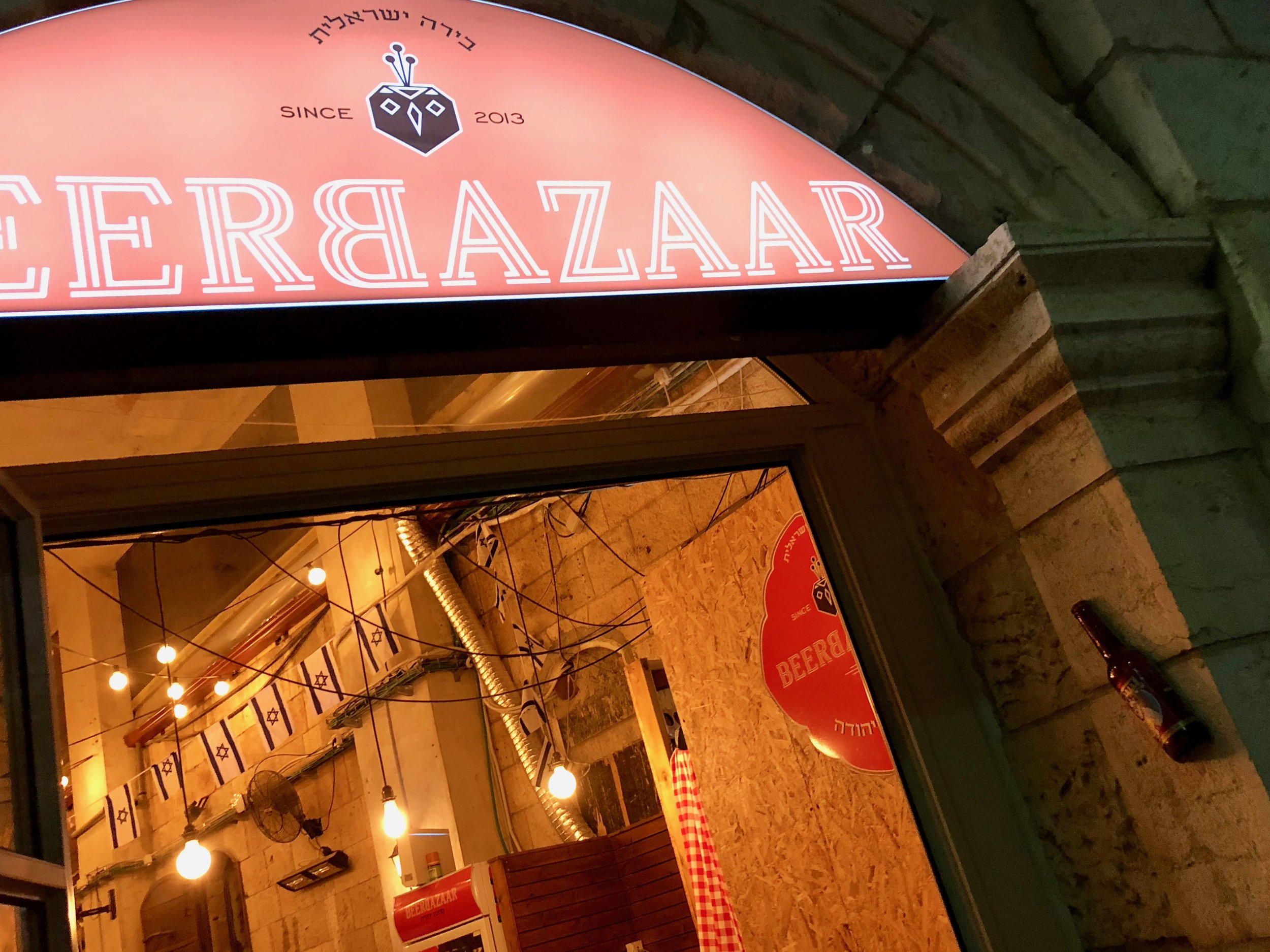 Yes, that beer bottle on the door post is a Mezuzah!