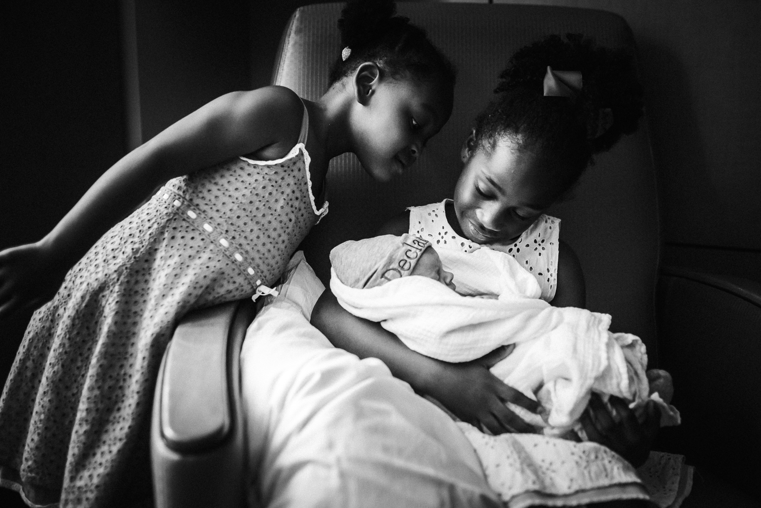 These two big sister were over the moon about meeting their baby brother!