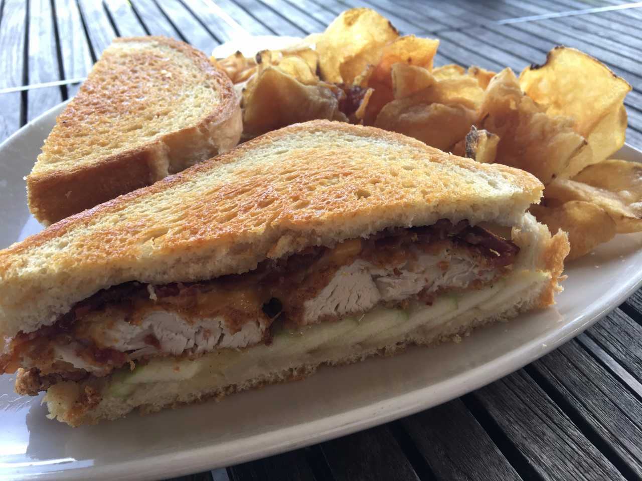 "Chef's Ultimate Grilled Cheese - toasted cheddar & pepper jack cheese with fried tenders, apple slices & bacon.   ""The apples add a sweet crunch to the smoky bacon & our signature tenders."""