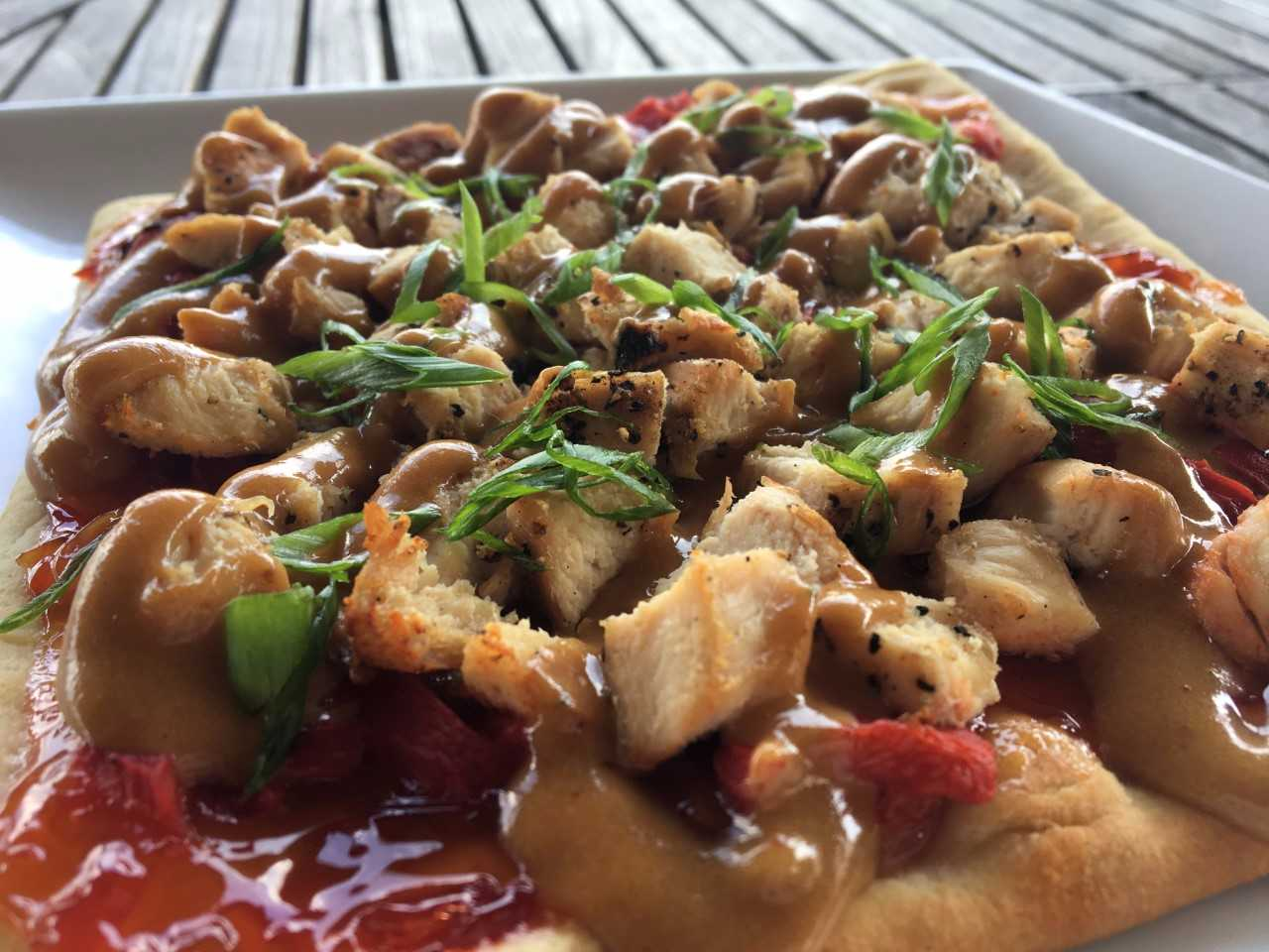 "Thai Chicken Flatbread - sweet chili chicken, roasted red peppers, green onion & cilantro drizzled with spicy peanut sauce.   ""Just one of our four flatbreads on the new menu. This one is a take on Pad Thai."""