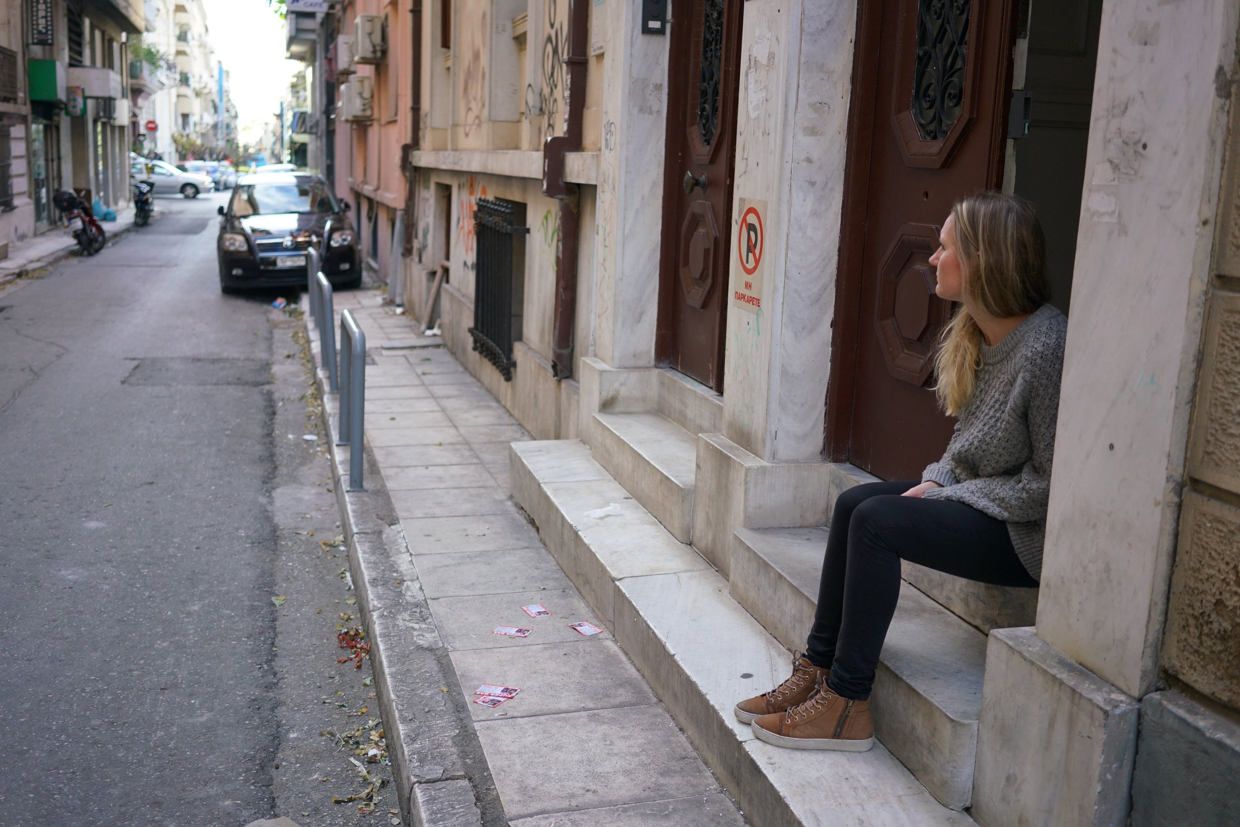 Patricia Kirk sits outside the Faros home for unaccompanied minors in Athens, Greece. Photo: Talitha Brauer