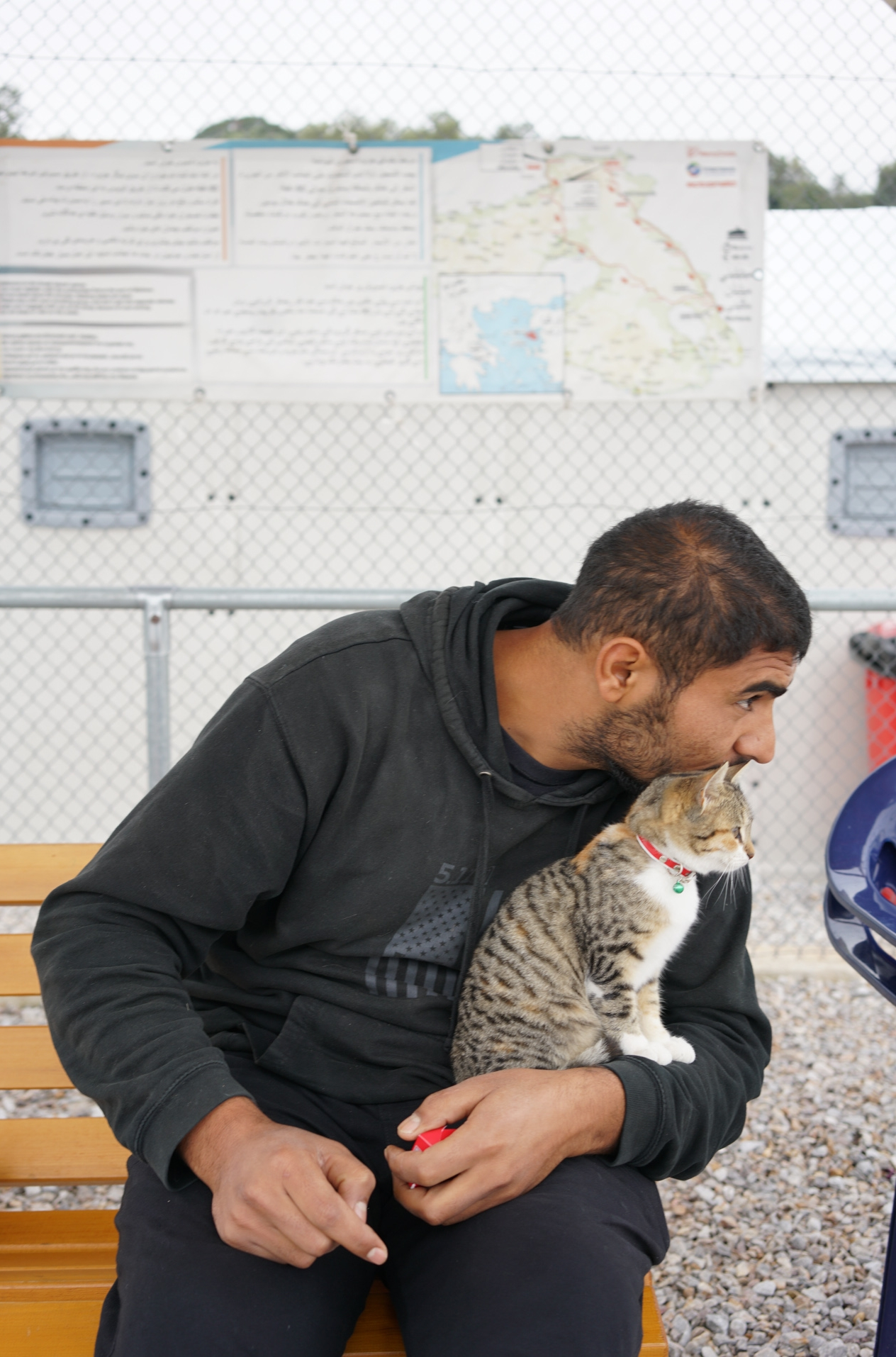 Adil and his cat Tuesday, Skala Sikamineas, Greece. Photo: Talitha Brauer