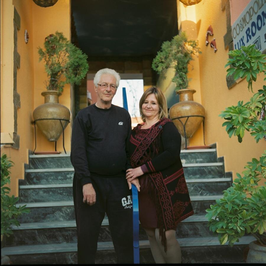 Andreas & Gina outside Cosmopolitan hotel. March 2017. Lesvos, Greece. photo: Talitha Brauer