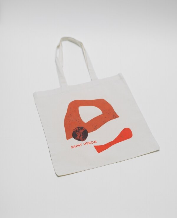 Saint Heron Tote Bags