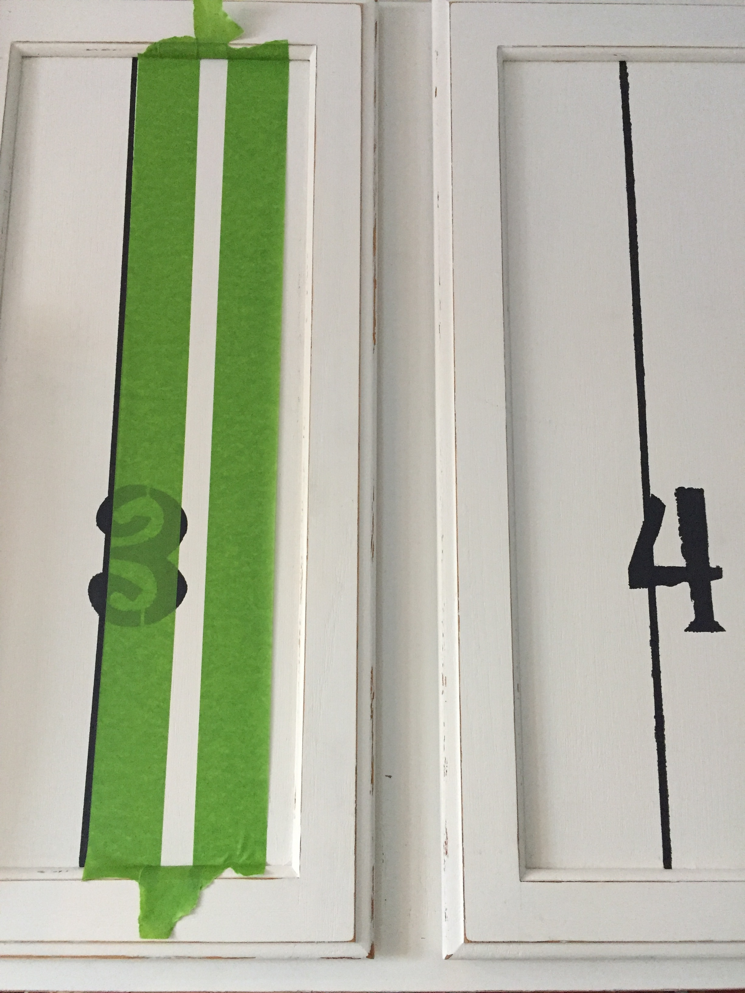 Taping off stripes in 3 different widths.