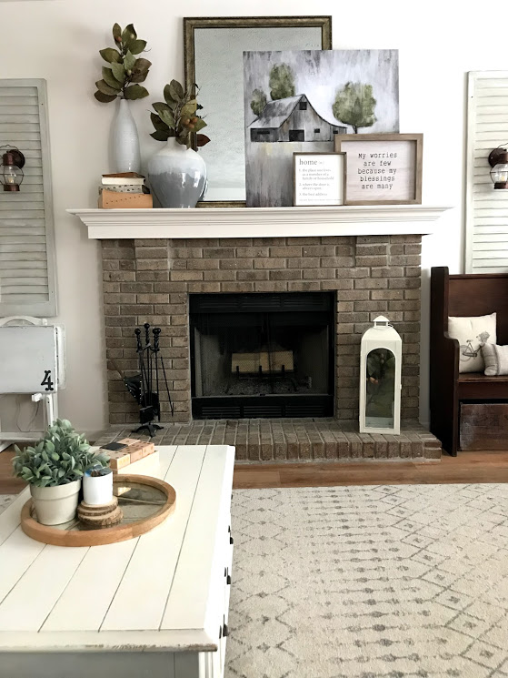 Builder Grade fireplace with brick surround, before