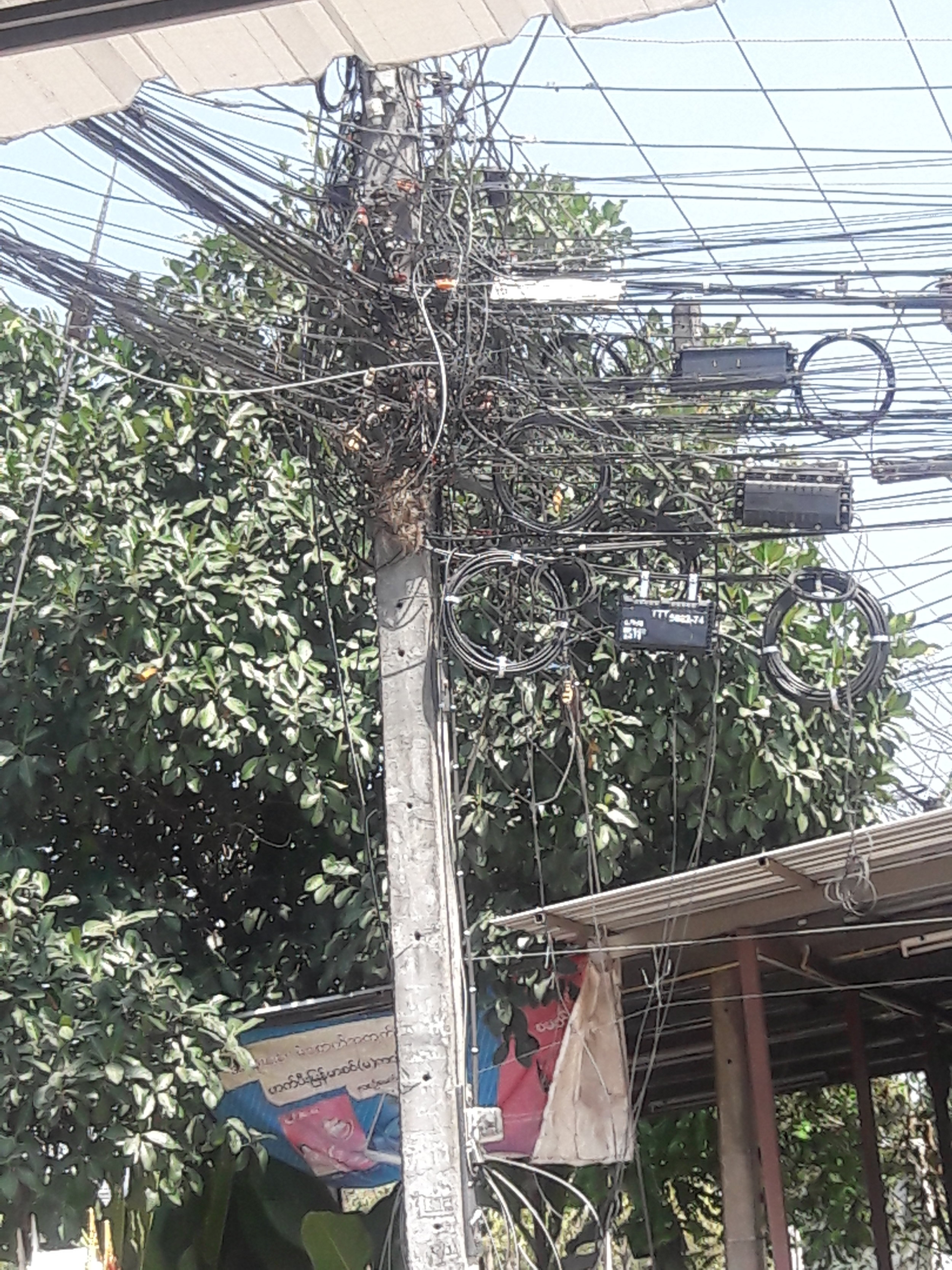 Clustered power lines seen in Thailand.