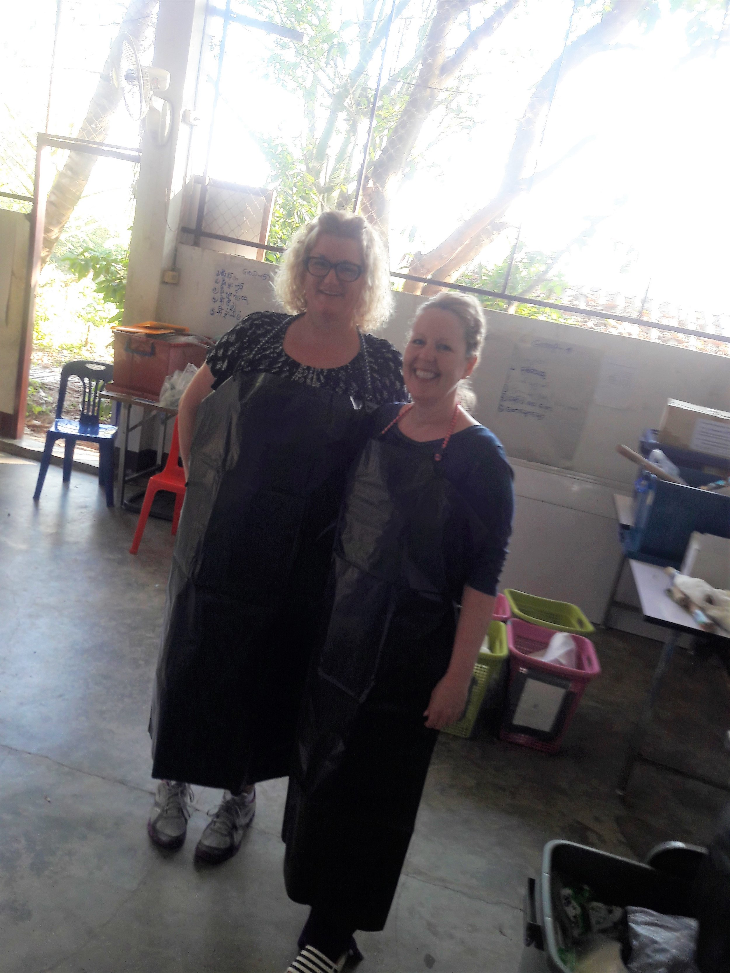 Our nurse, Tracy, and another nurse on the team prepping to teach during the pig lab.