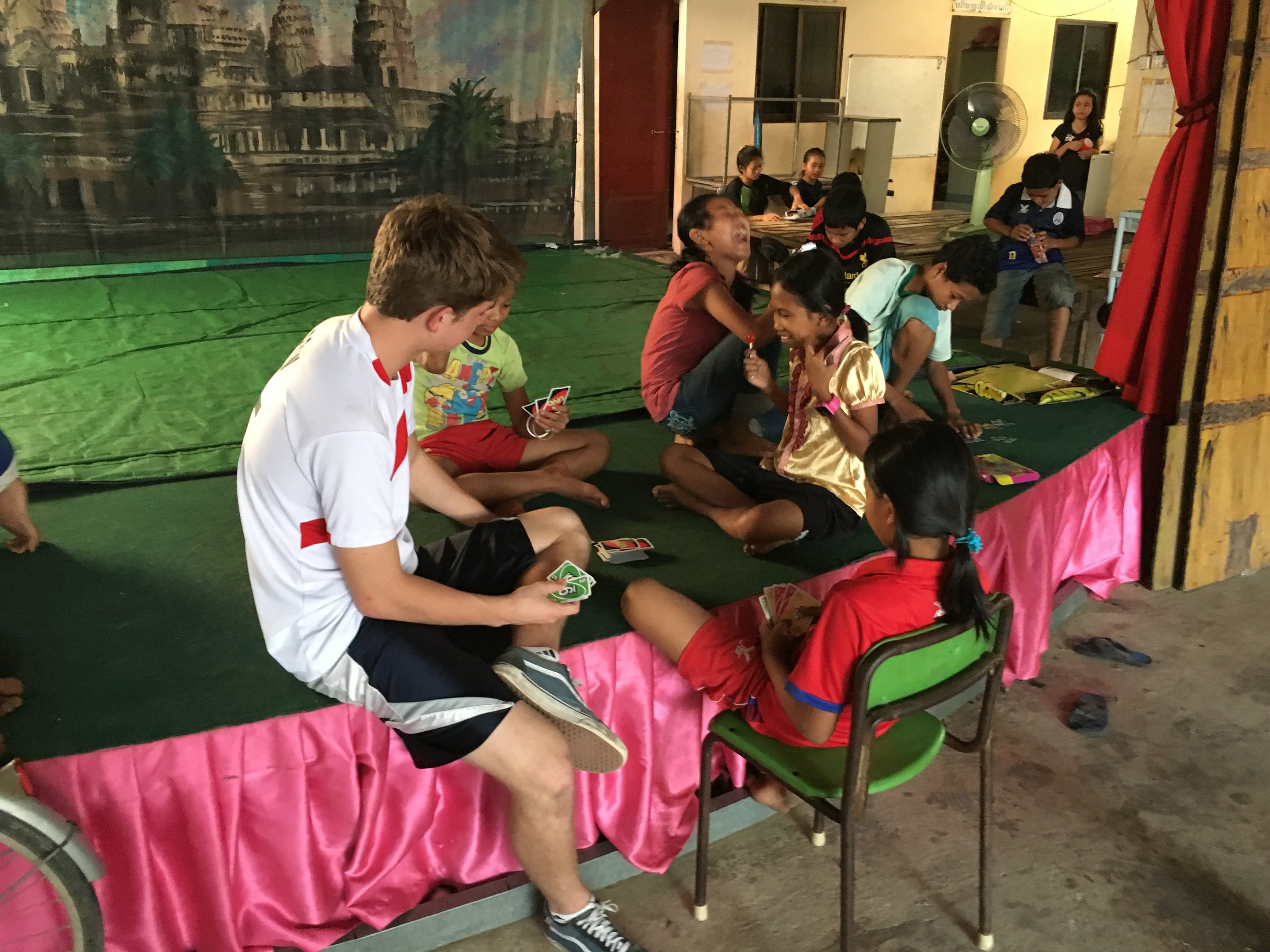Andrew playing Uno with the local children.