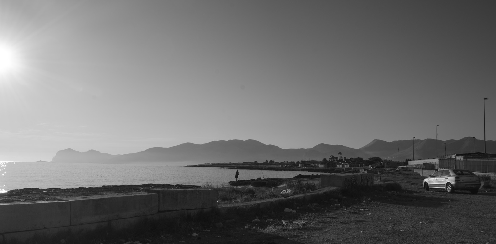 During a frustrating dawn walk down a long road from the Palermo airport after a missed flight, I was given this incredible view of the city's outskirts. In the morning surf, fishermen stood patiently on the rocks to catch the day's meal.