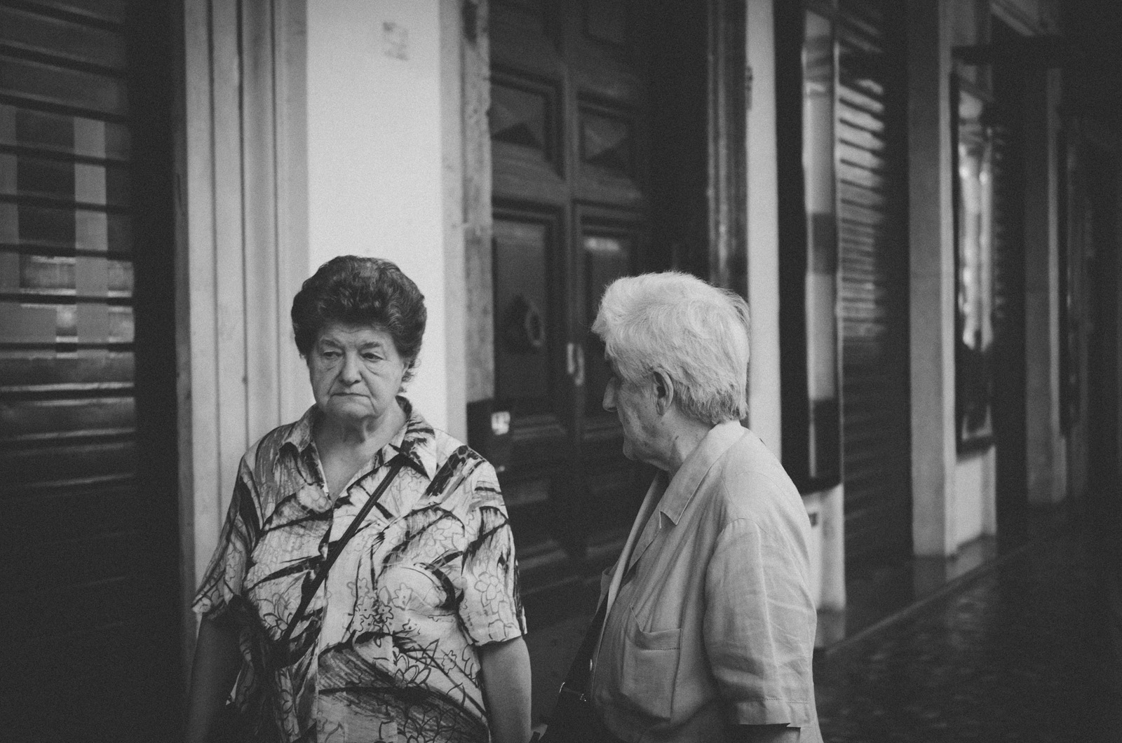 Two locals going about their business in Rome. Once you get away from Rome's bustling tourist center near the famous ruins, the city provides a much more intimate perspective on every day Italian life.