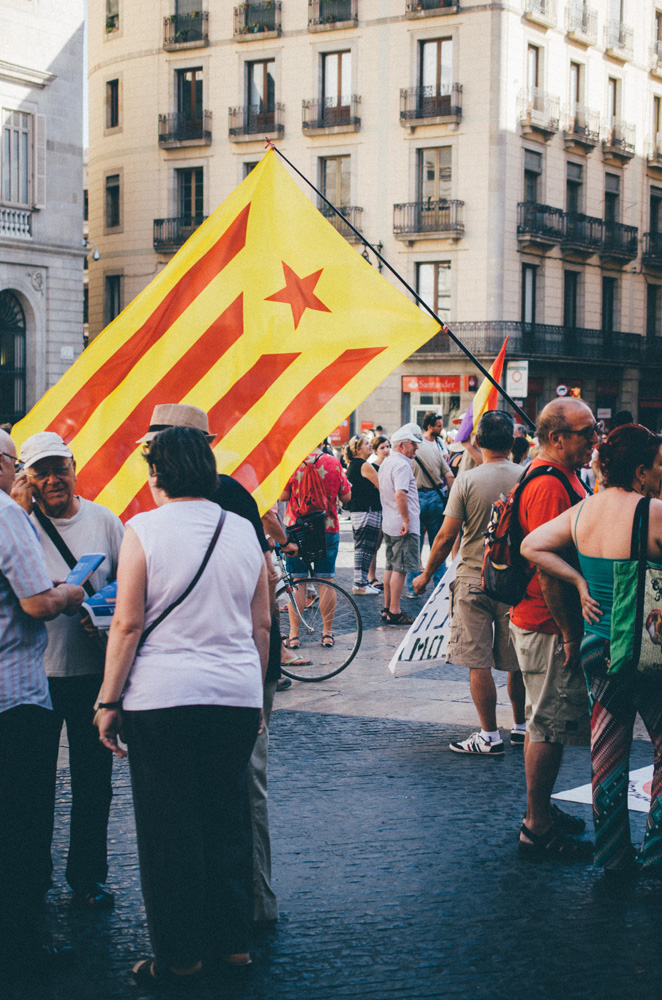 Outside of government buildings in Barcelona, political activists gather to show support for Catalonian independence. For many years, the people of Catalunya - the region of Spain bordering southern France and surrounding Barcelona - have demonstrated interest in making their region a country independent from the rest of Spain.
