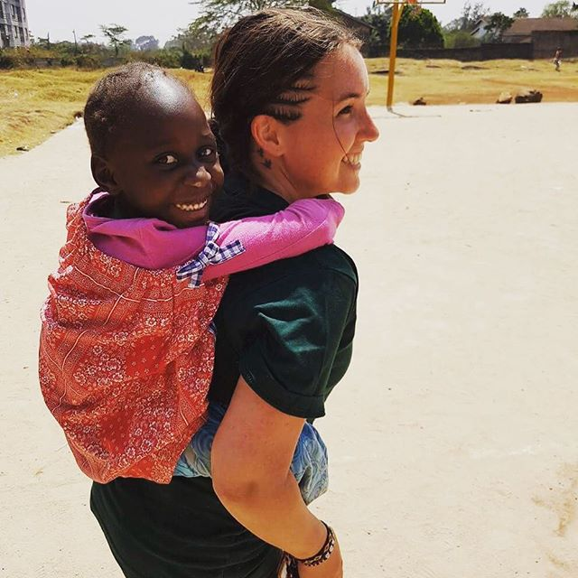 Volunteer Kirsty and Eve are all smiles on a day out in Kibera.