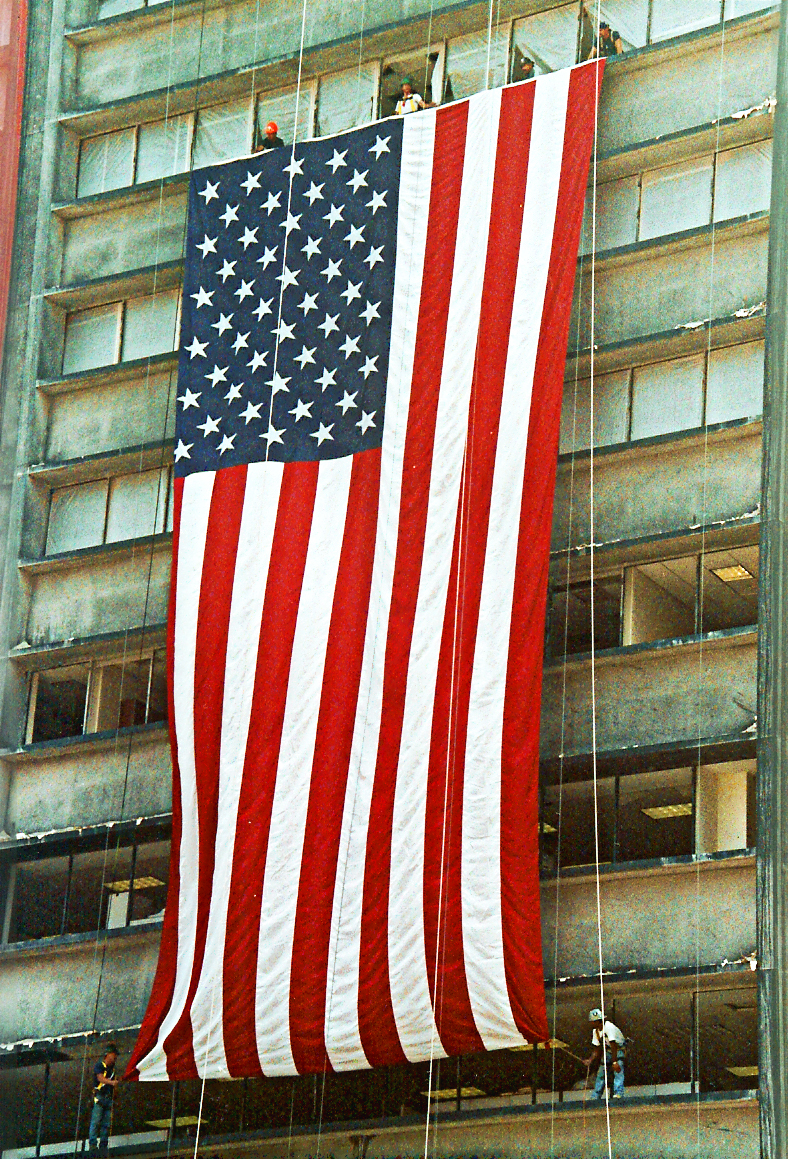 The Ground Zero Flag displayed on 1 Liberty in September 2001.  Photograph by: Denise Lutrey Casalinuovo.